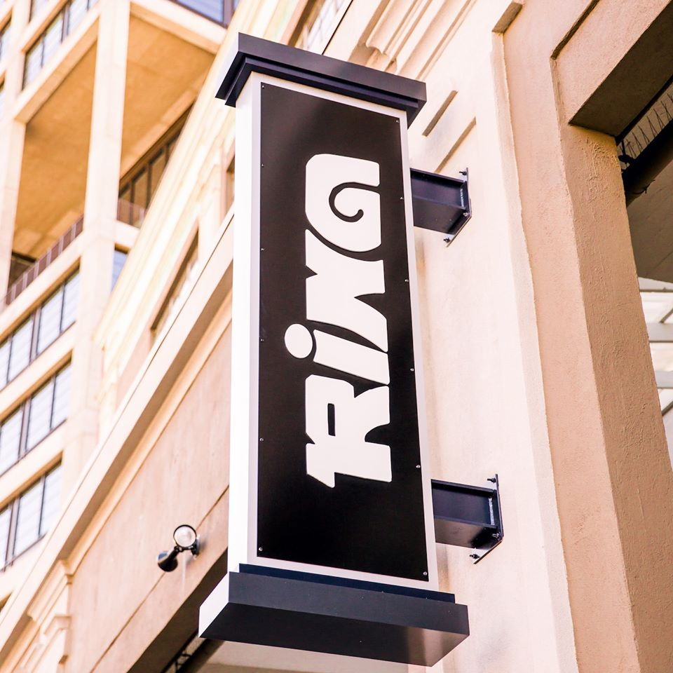 The vertical light up Rina sign outside the restaurant at Ford Factory Lofts in Atlanta