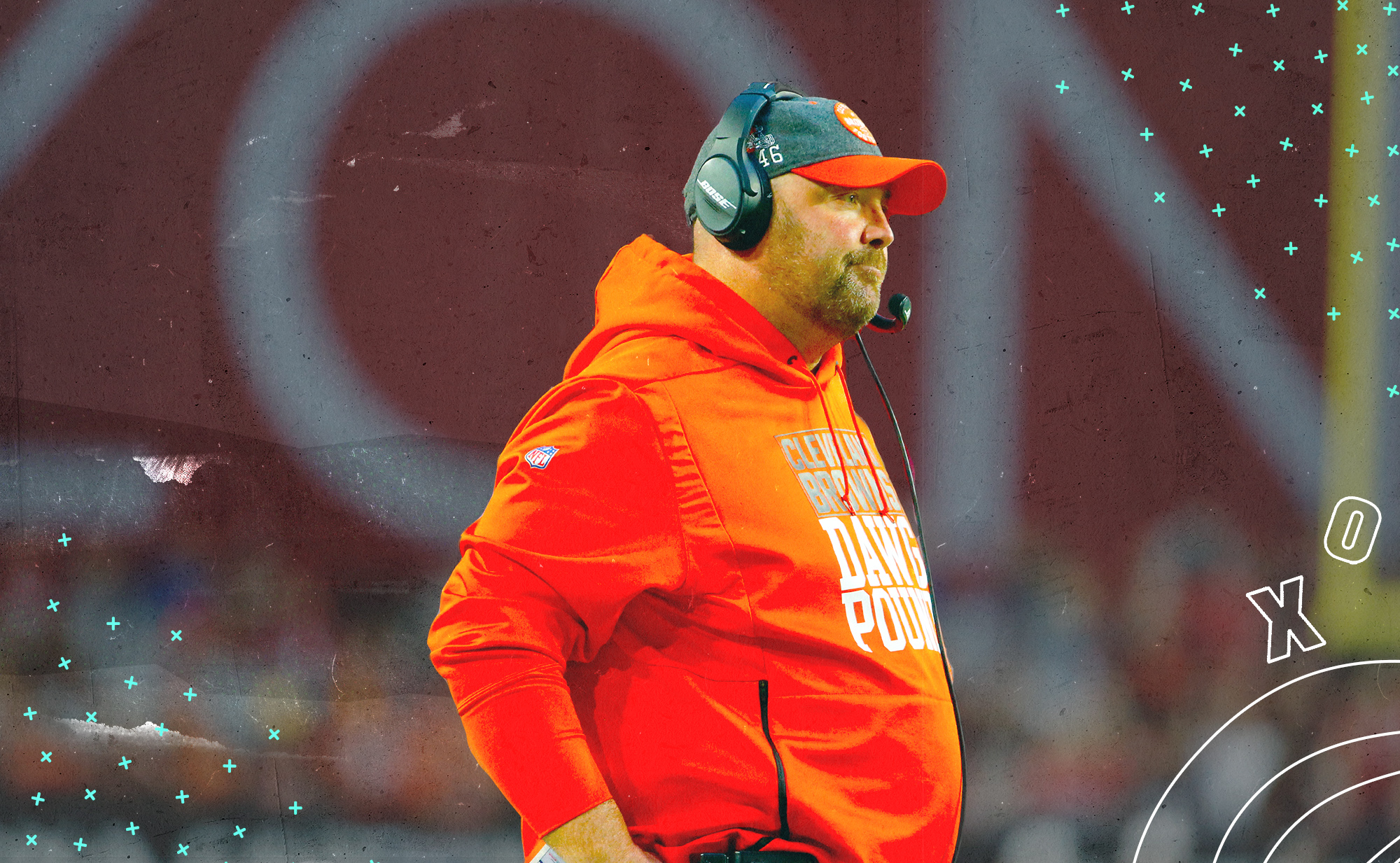 A side profile of Browns coach Freddie Kitchens, wearing a headset, with white X's and O's in the background