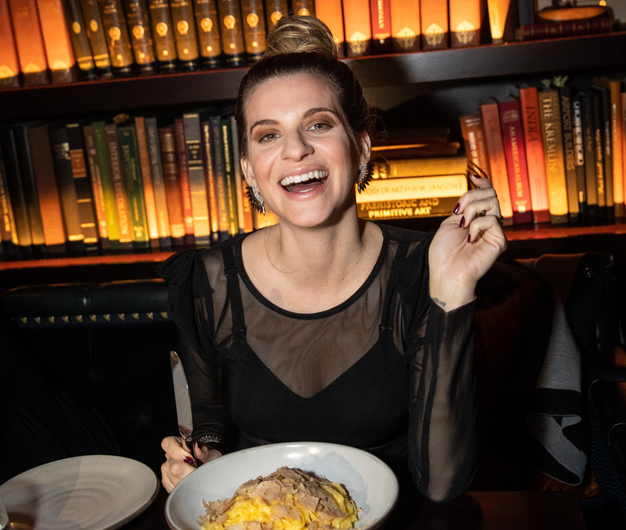 A model dines at a restaurant