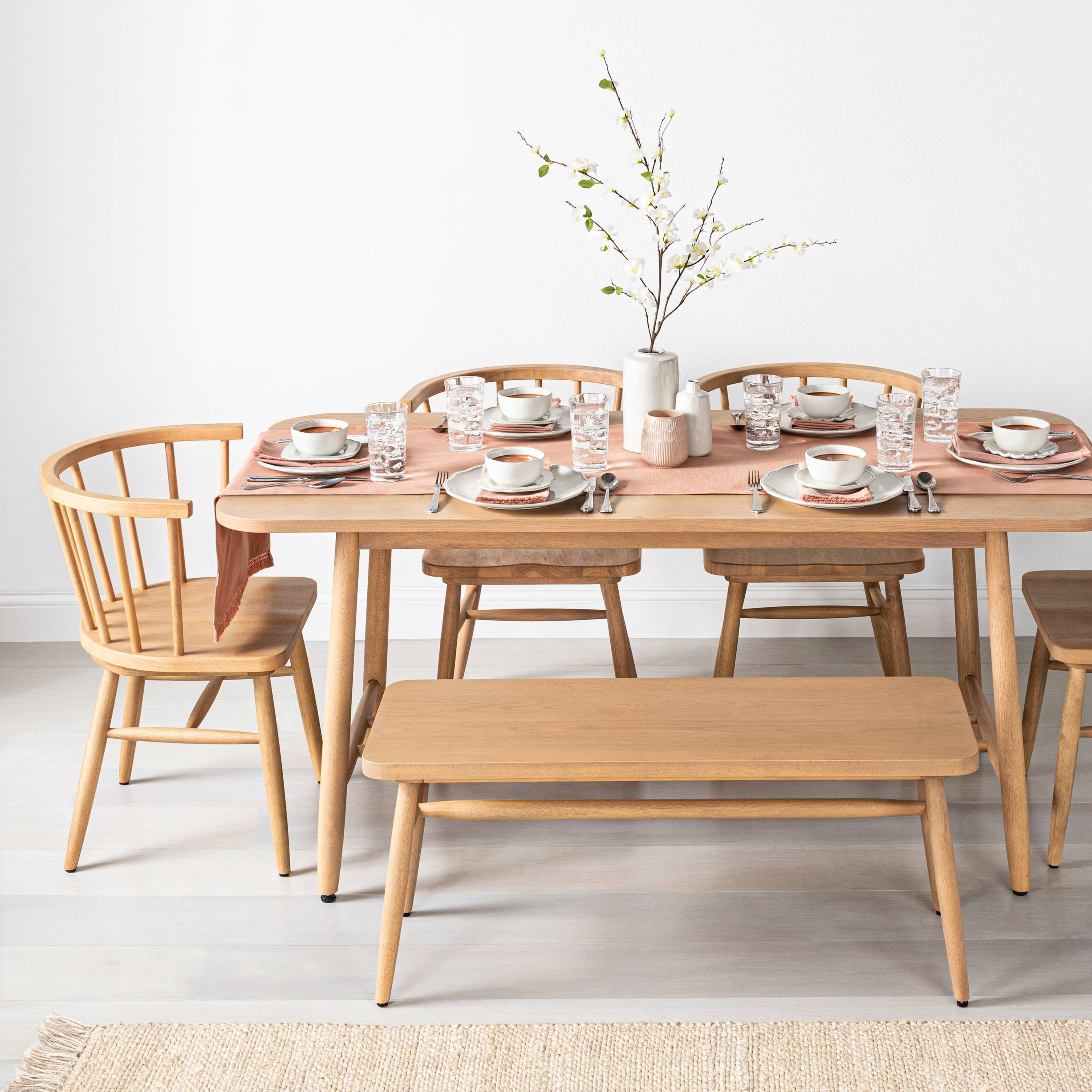 Pale wood table with table settings.
