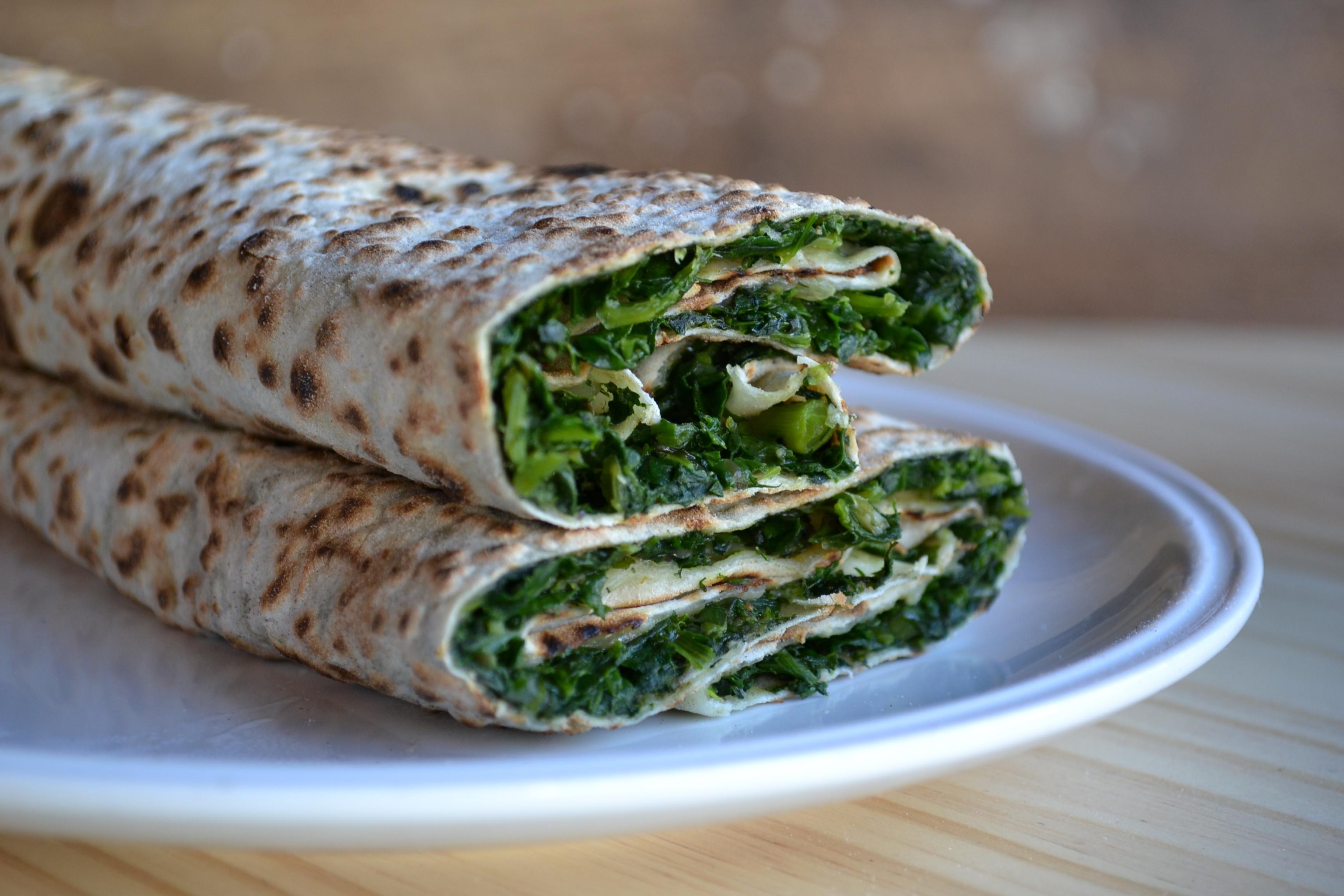 Vivid green greens and herbs fill Zhengyalov Hatz's signature flatbread.
