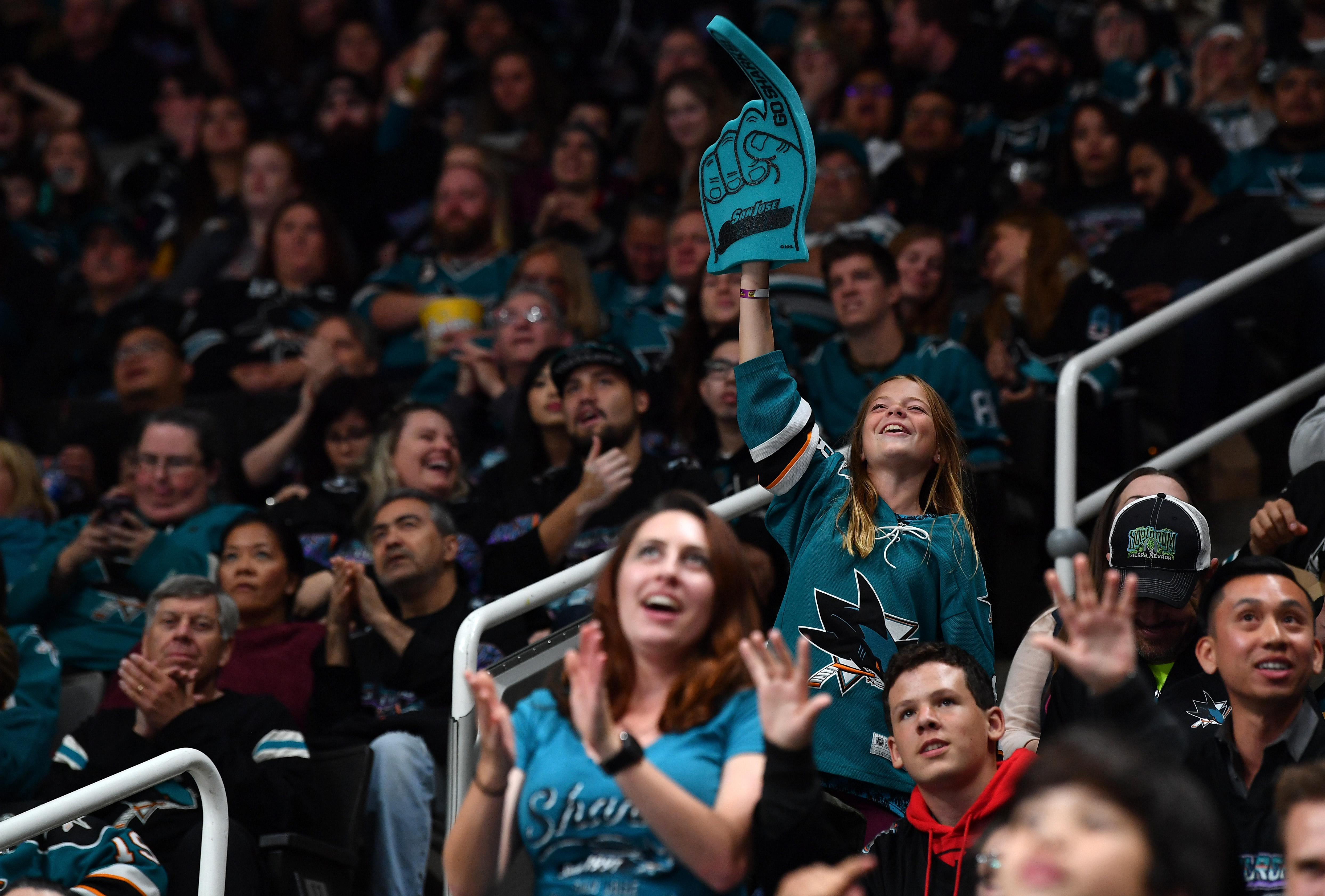 A fan cheers as the San Jose Sharks play against the Buffalo Sabres at SAP Center on October 19, 2019 in San Jose, California.