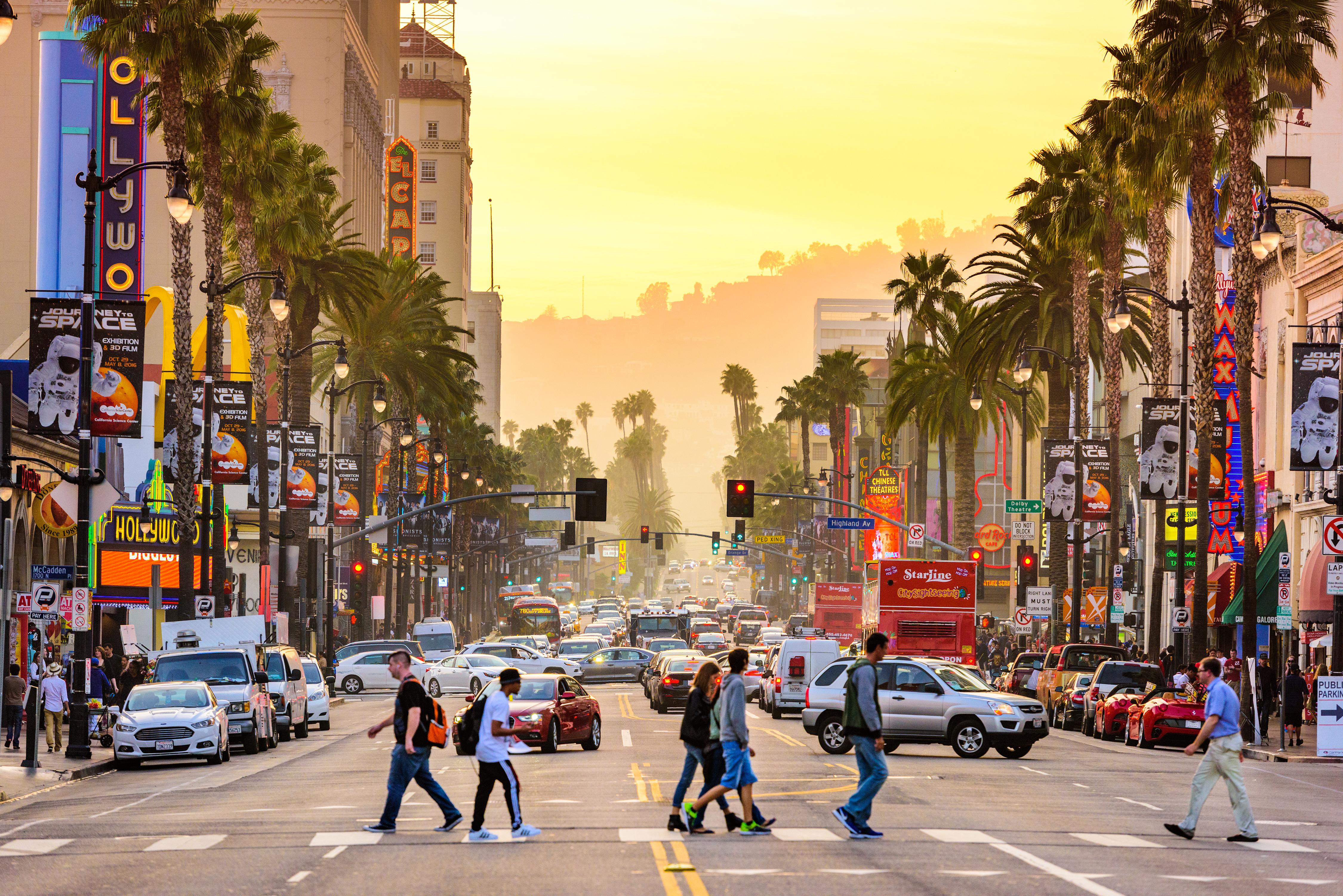 Pedestrians crossing a busy street in Los Angeles.
