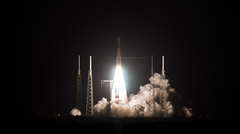 Rocket taking off against a black sky