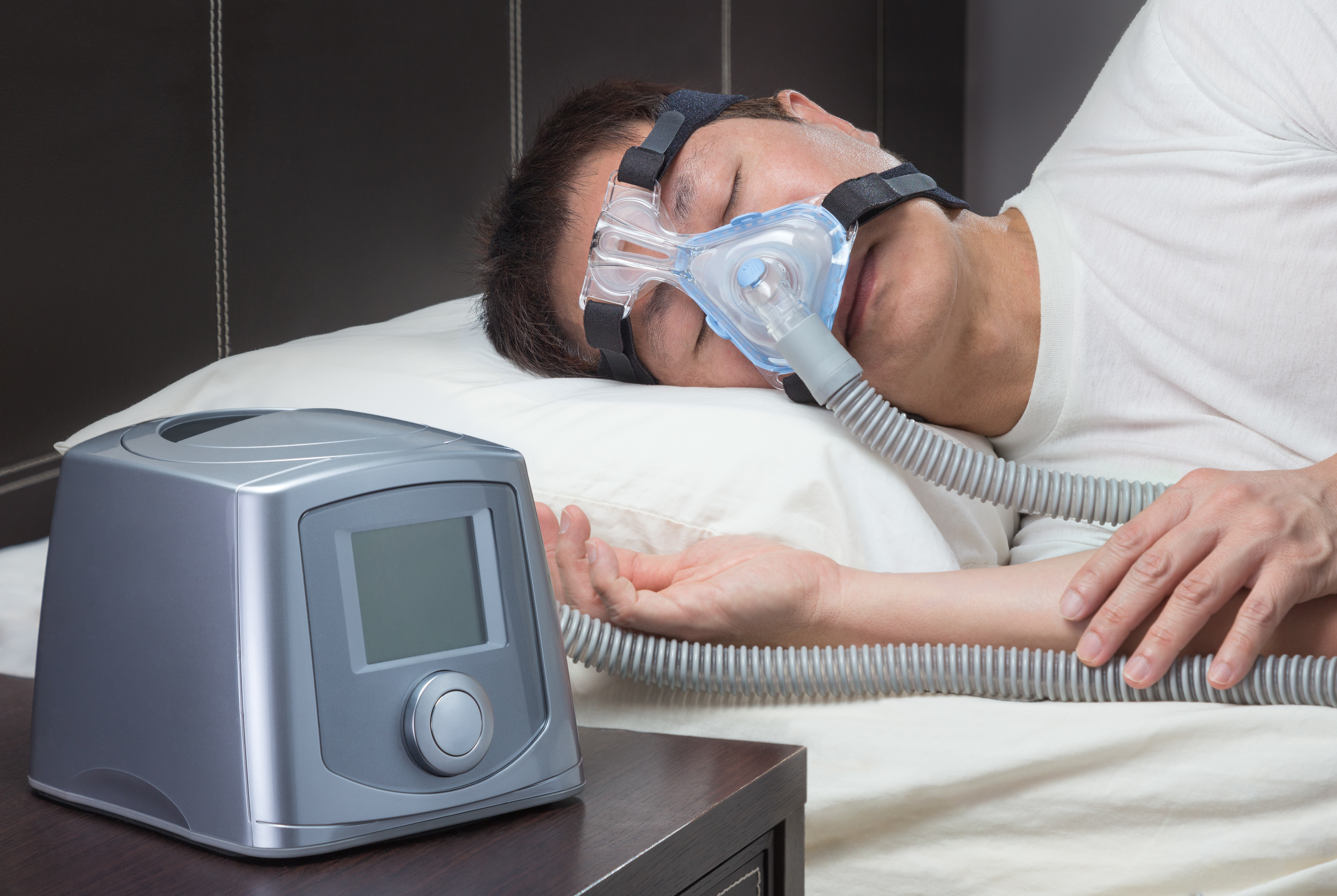 Getting used to even the idea of wearing a CPAP mask, such as this, to bed for sleep apnea can be hard for many people.