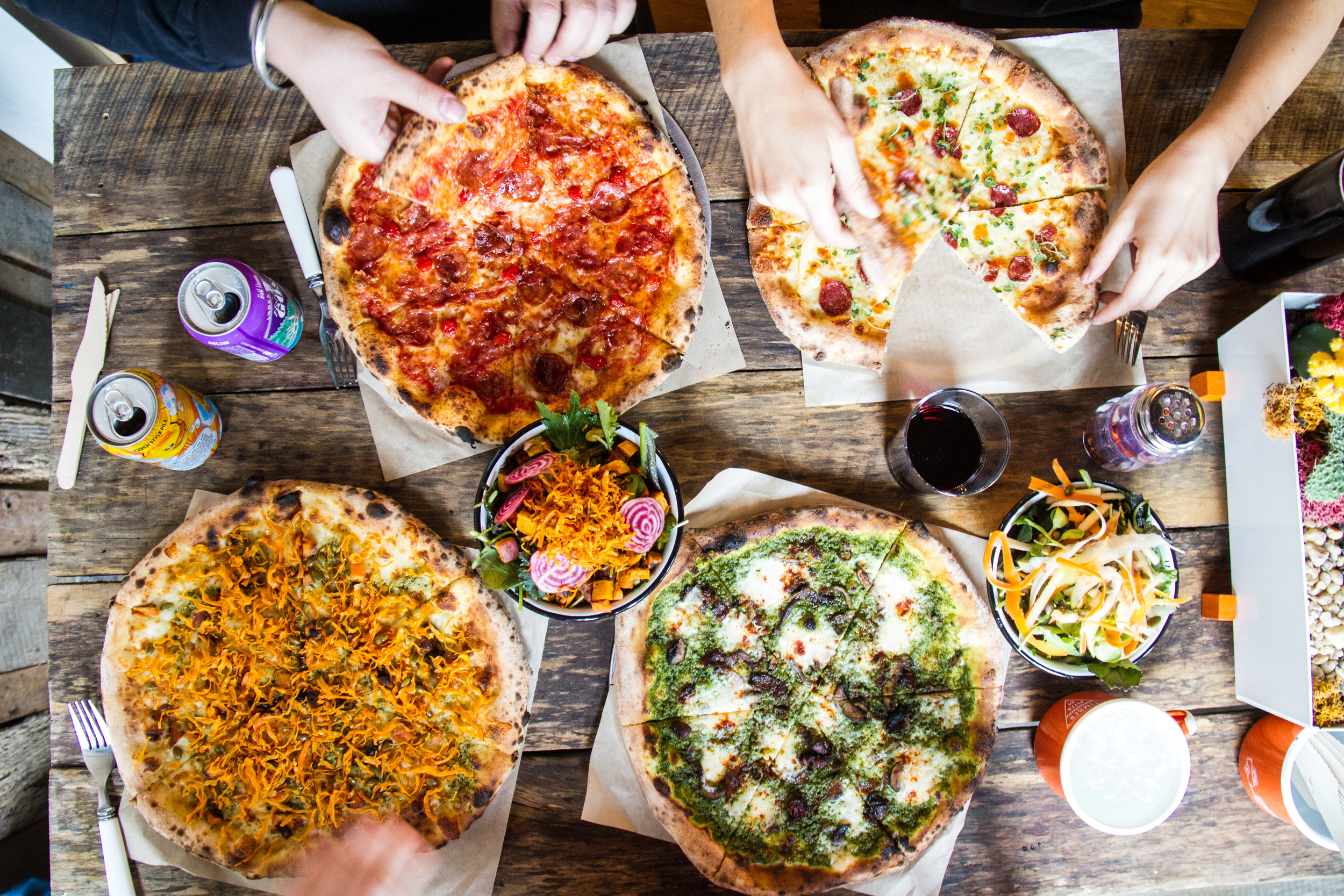 Four pizzas with various toppings from Timber Pizza Co.