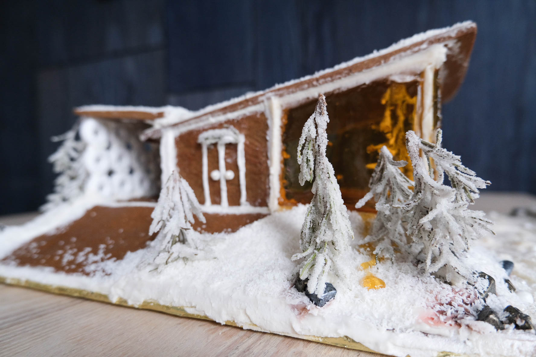 Midcentury modern gingerbread house with slanted roof.