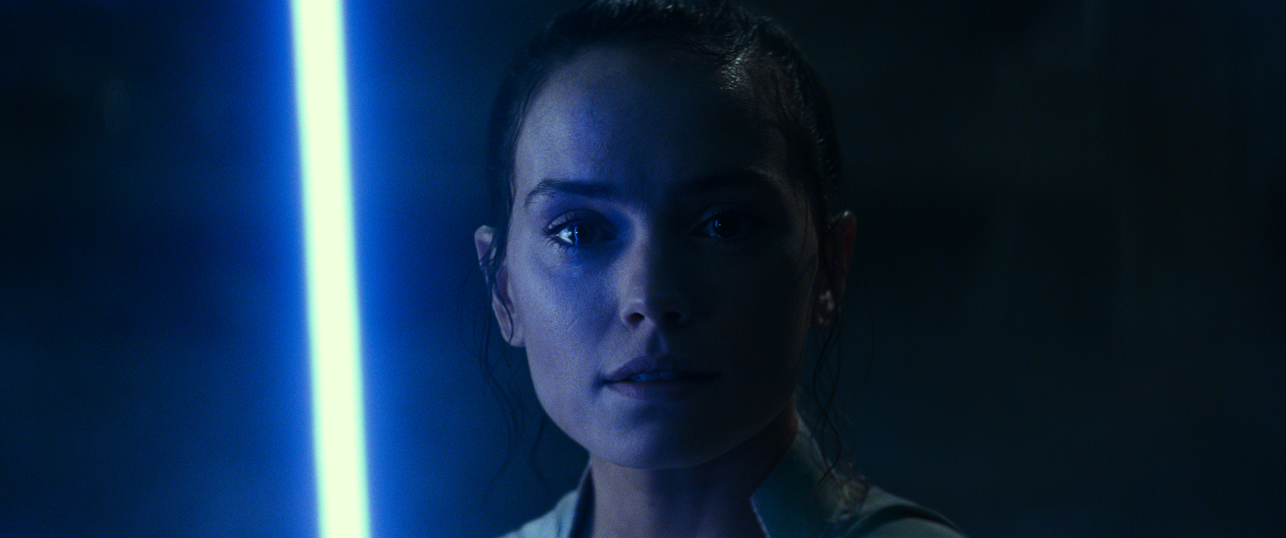 Rey with a lightsaber in Star Wars: The Rise of Skywalker
