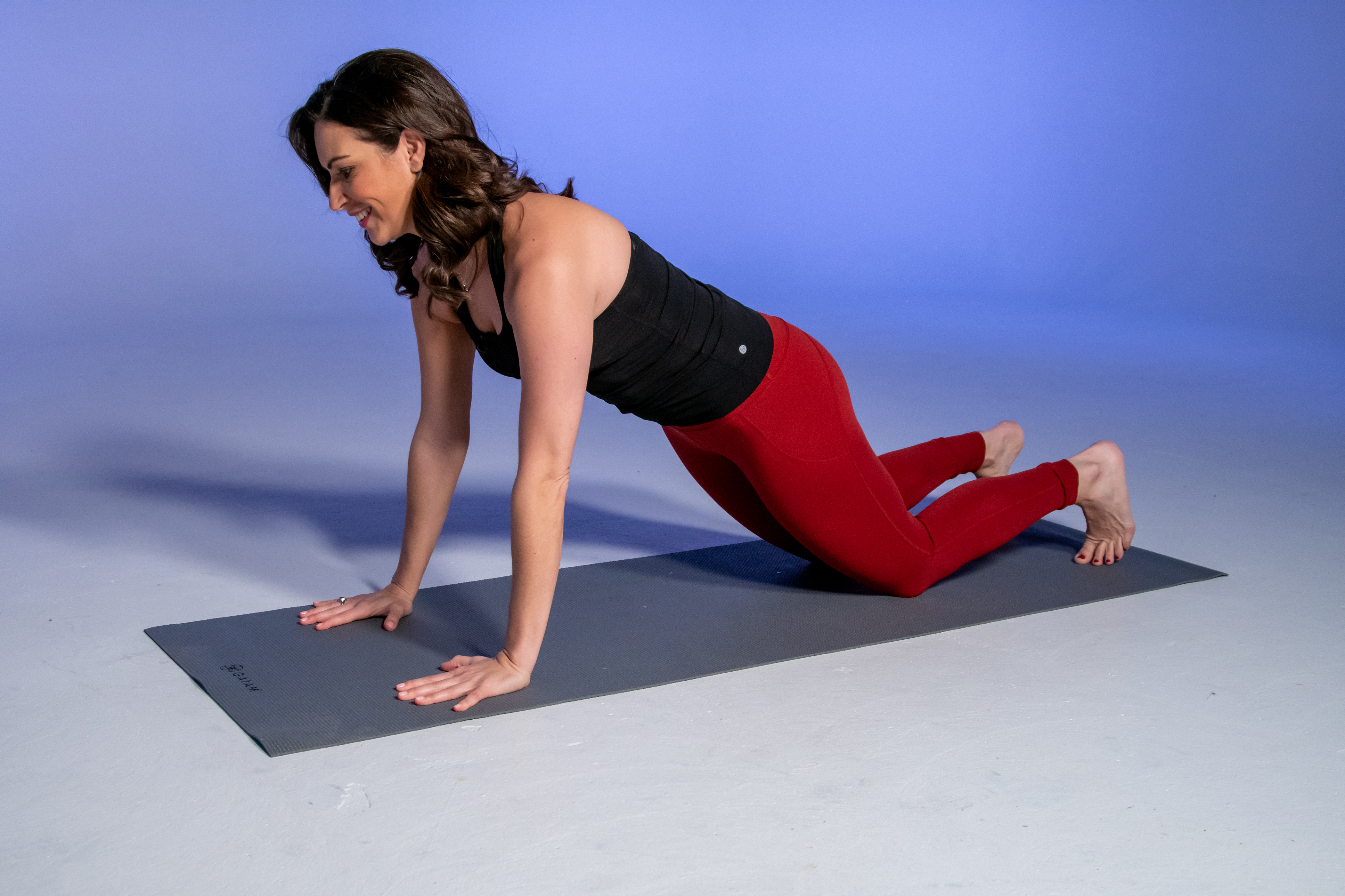 Stephanie Mansour demonstrates the starting position of a push-up that can be done on the floor or against the counter in your kitchen.