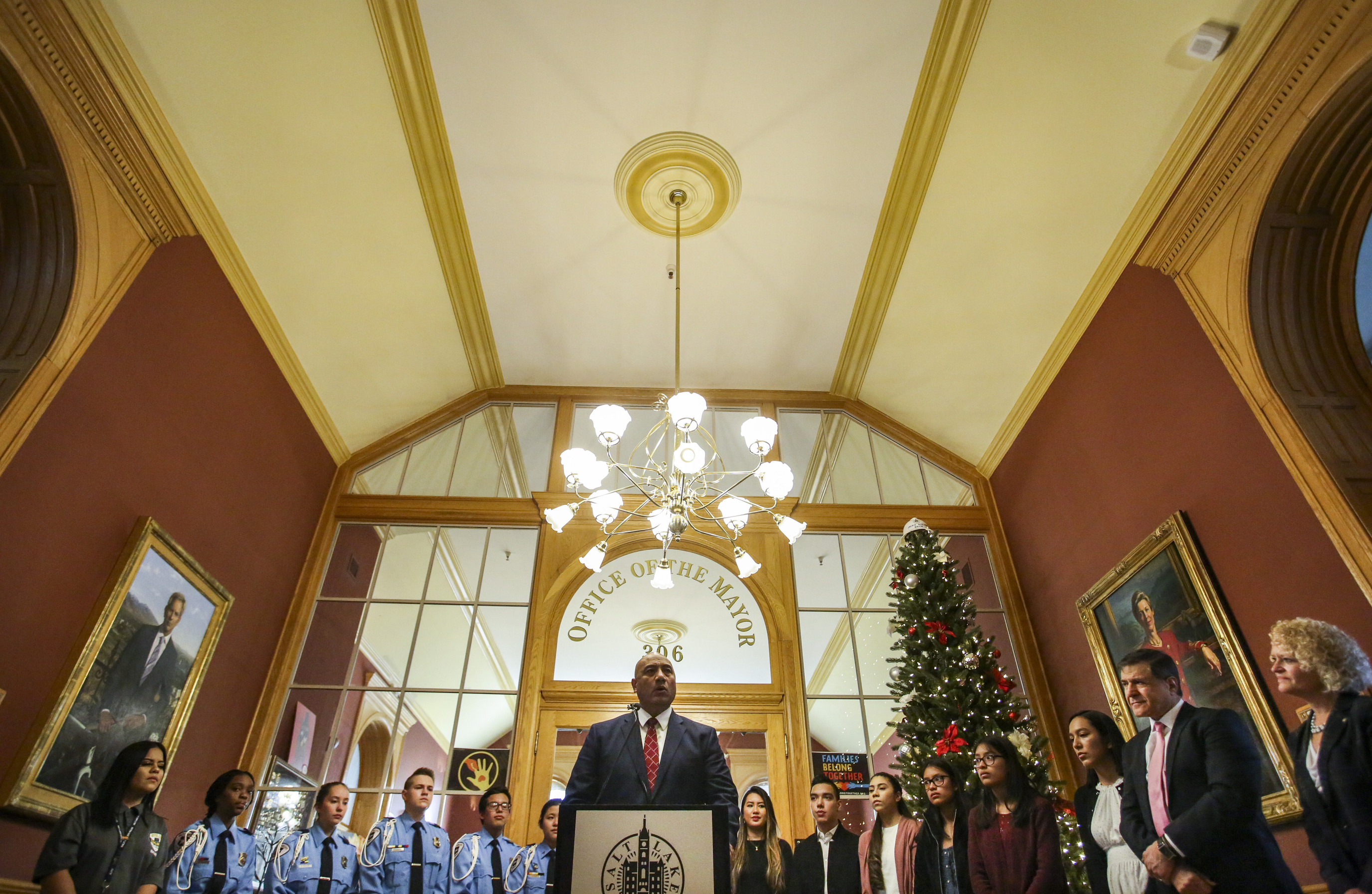 Richard Kaufusi, front center,director of the University of Utah Eccles School of Business Opportunity Scholars Program, speaks during the announcement of the HOPE Scholarship at the Mayor's Office at the Salt Lake City-County Building on Friday, Dec. 20, 2019. The scholarship is designed to support the city's low-income student residents who are the first in their families to attend college.