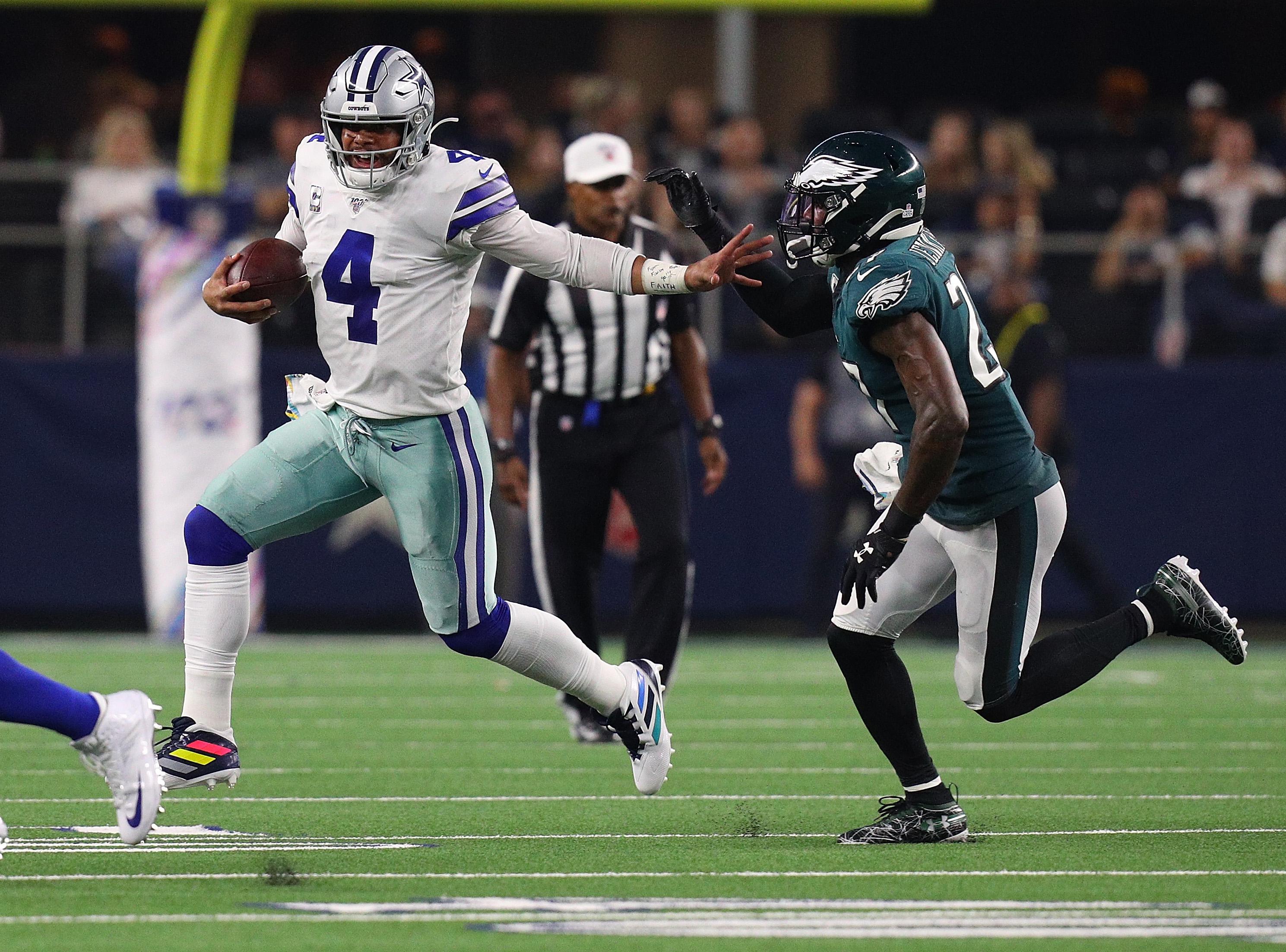 Dallas Cowboys QB Dak Prescott runs away Philadelphia Eagles S Malcolm Jenkins in Week 7, Oct. 20, 2019.