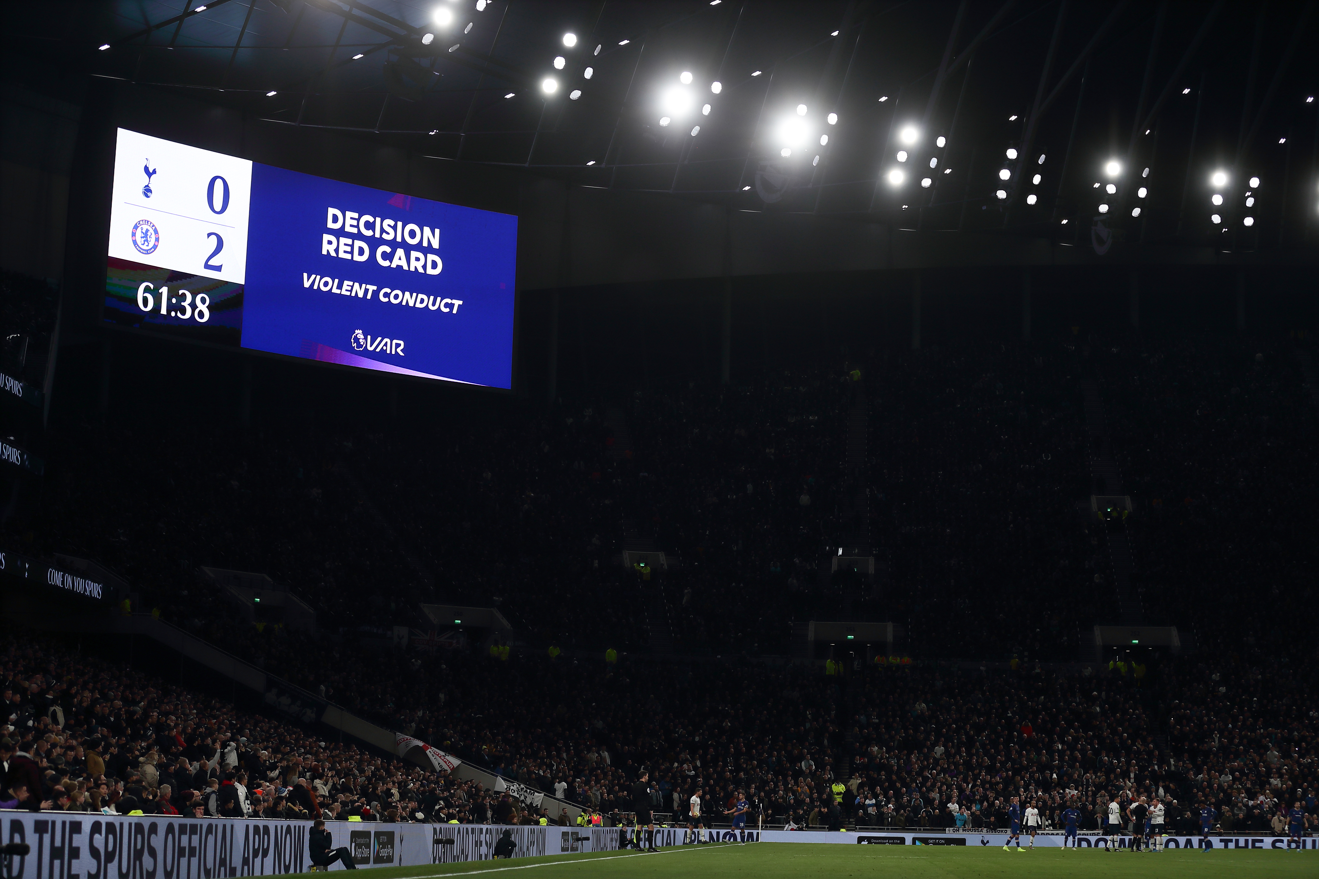 Son Heung-Min is sent off after a VAR check for kicking Antonio Rudiger.