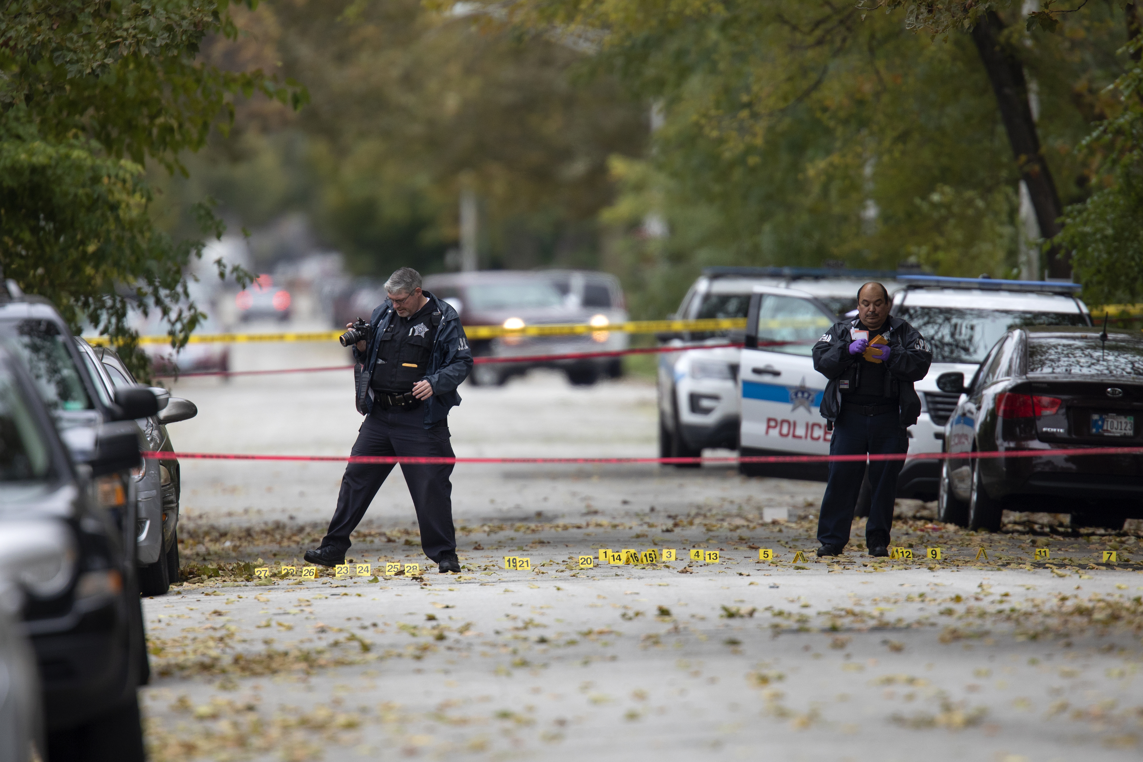 2 gunmen wound 13 at a Chicago house party honoring a gun violence victim