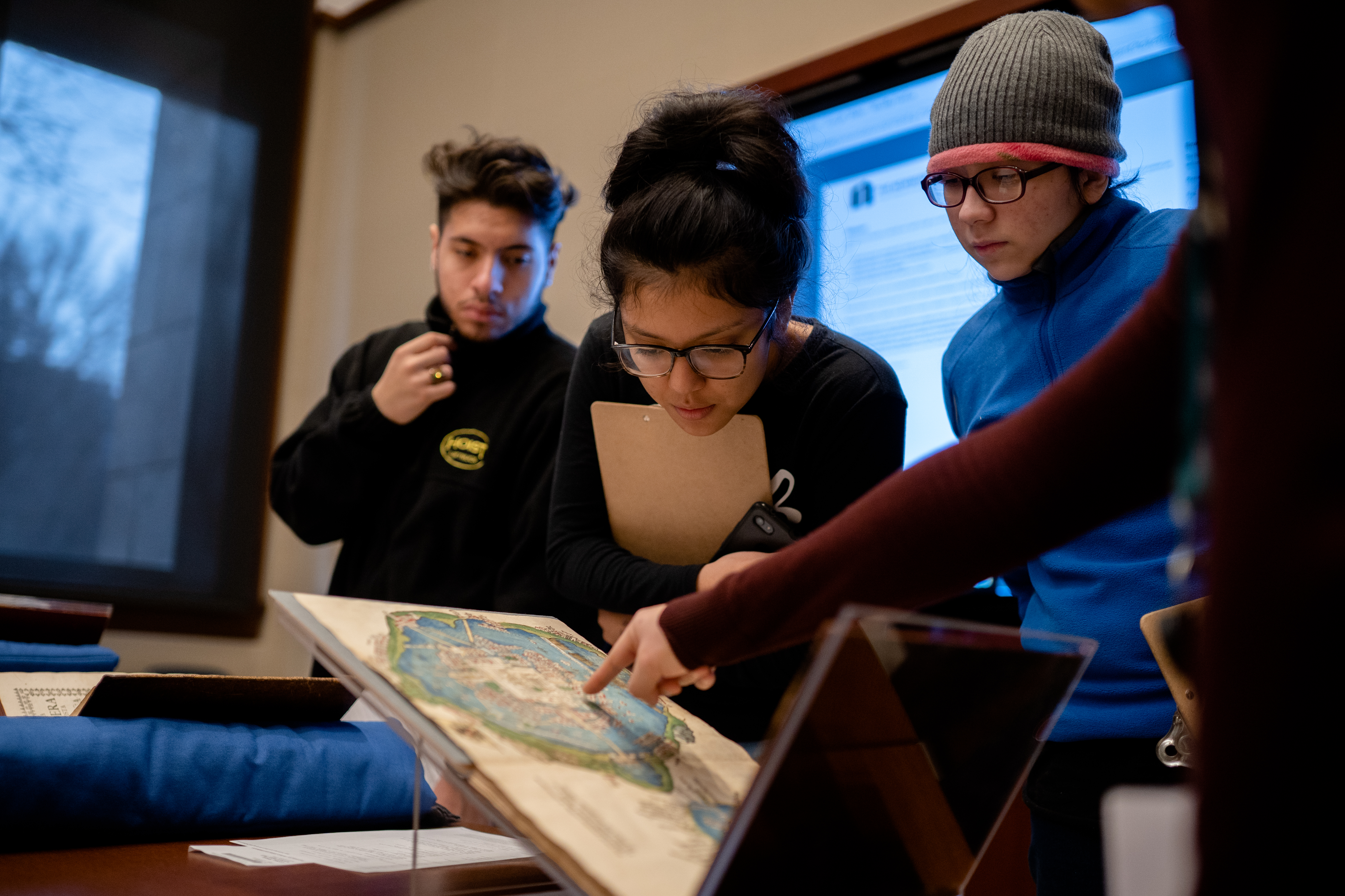 Isabel Quiroz looks at a 495-year-old map of Mexico City from the Edward E. Ayer collection at the Newberry Library on December 18, 2019.