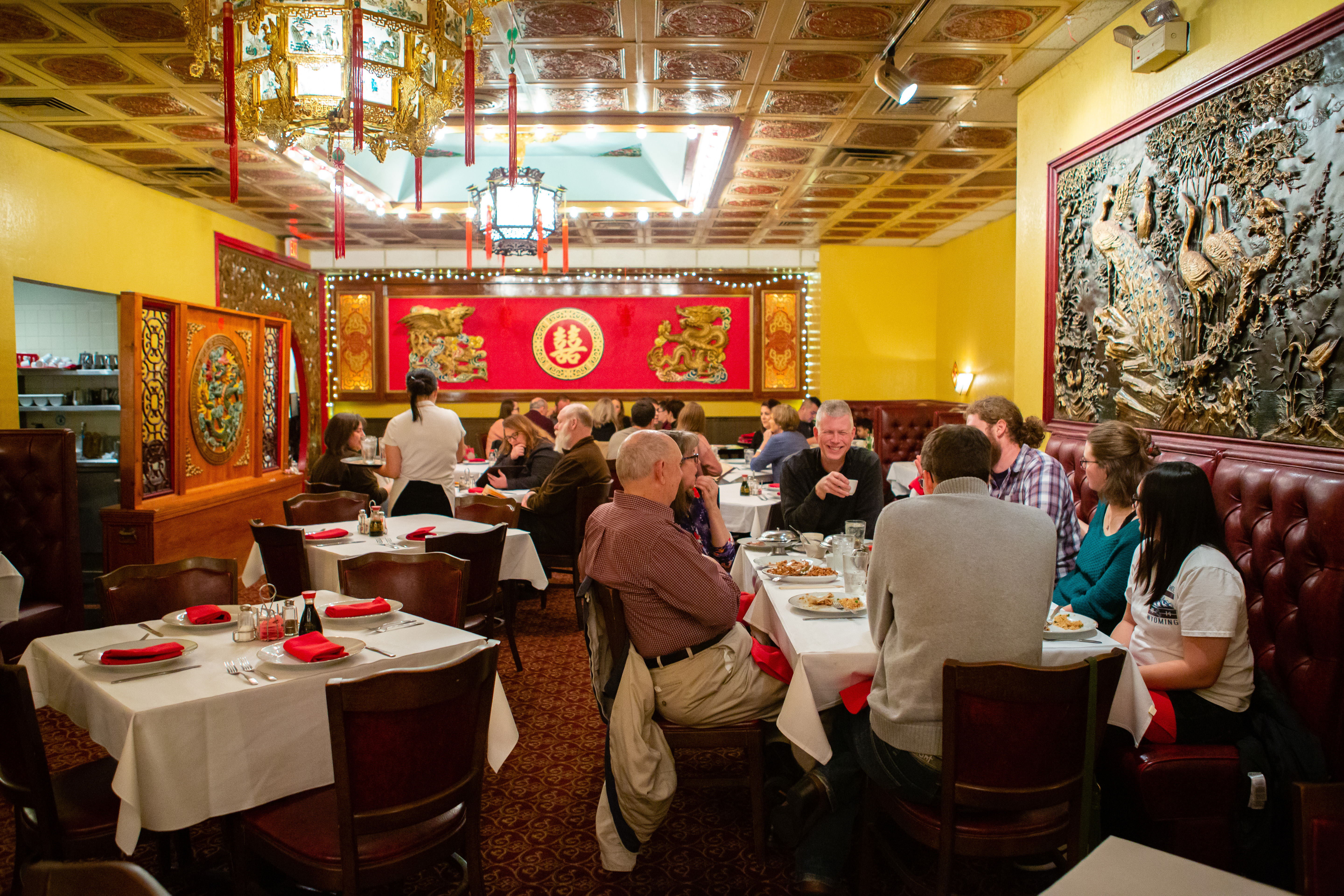 People seated at large tables in a Chinese restaurant.