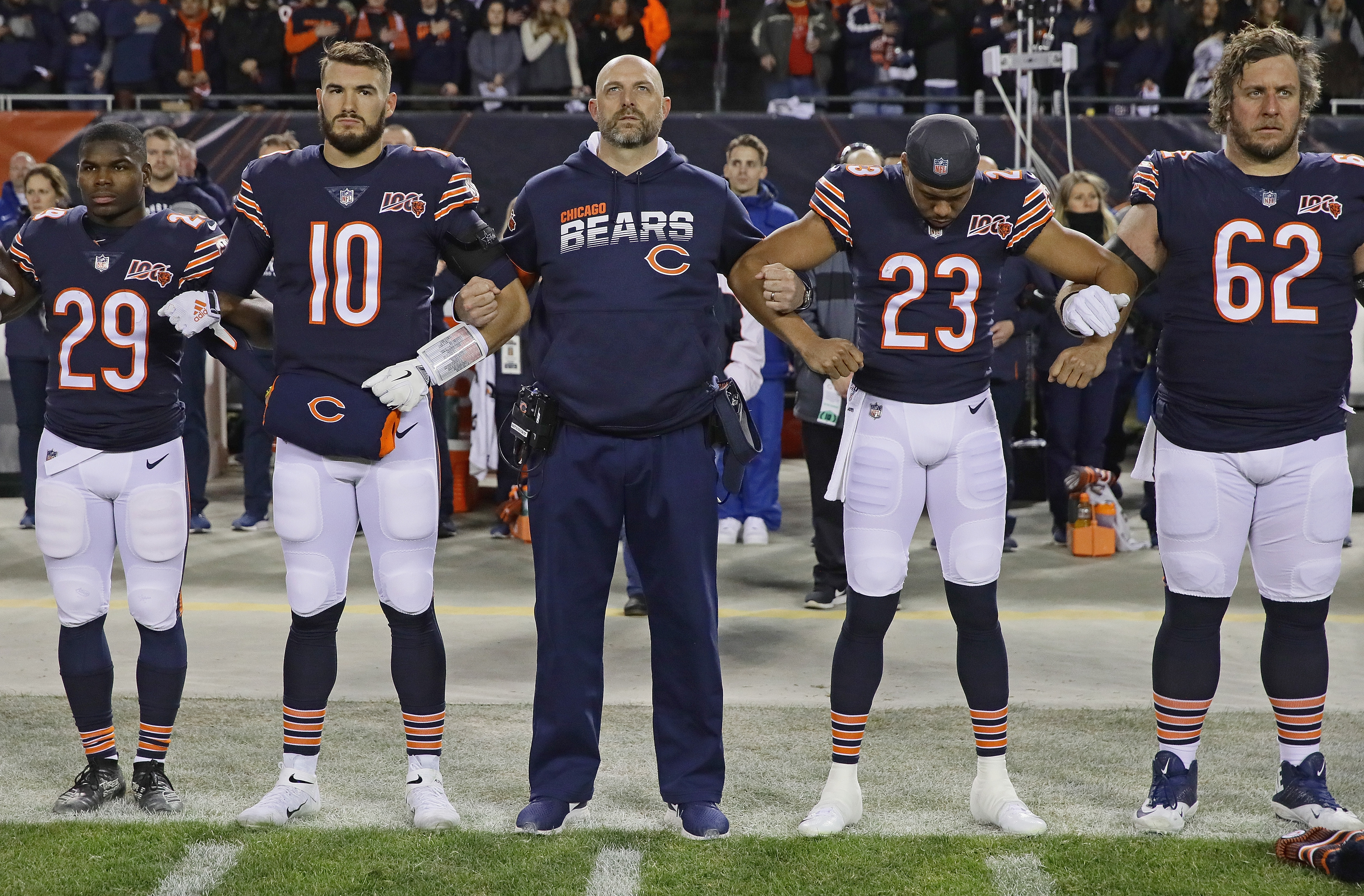 Bears coach Matt Nagy stands during the national anthem with, from left, Tarik Cohen, Mitch  Trubisky, Kyle Fuller and Ted Larsen before Sunday night's loss to the Kansas City Chiefs.