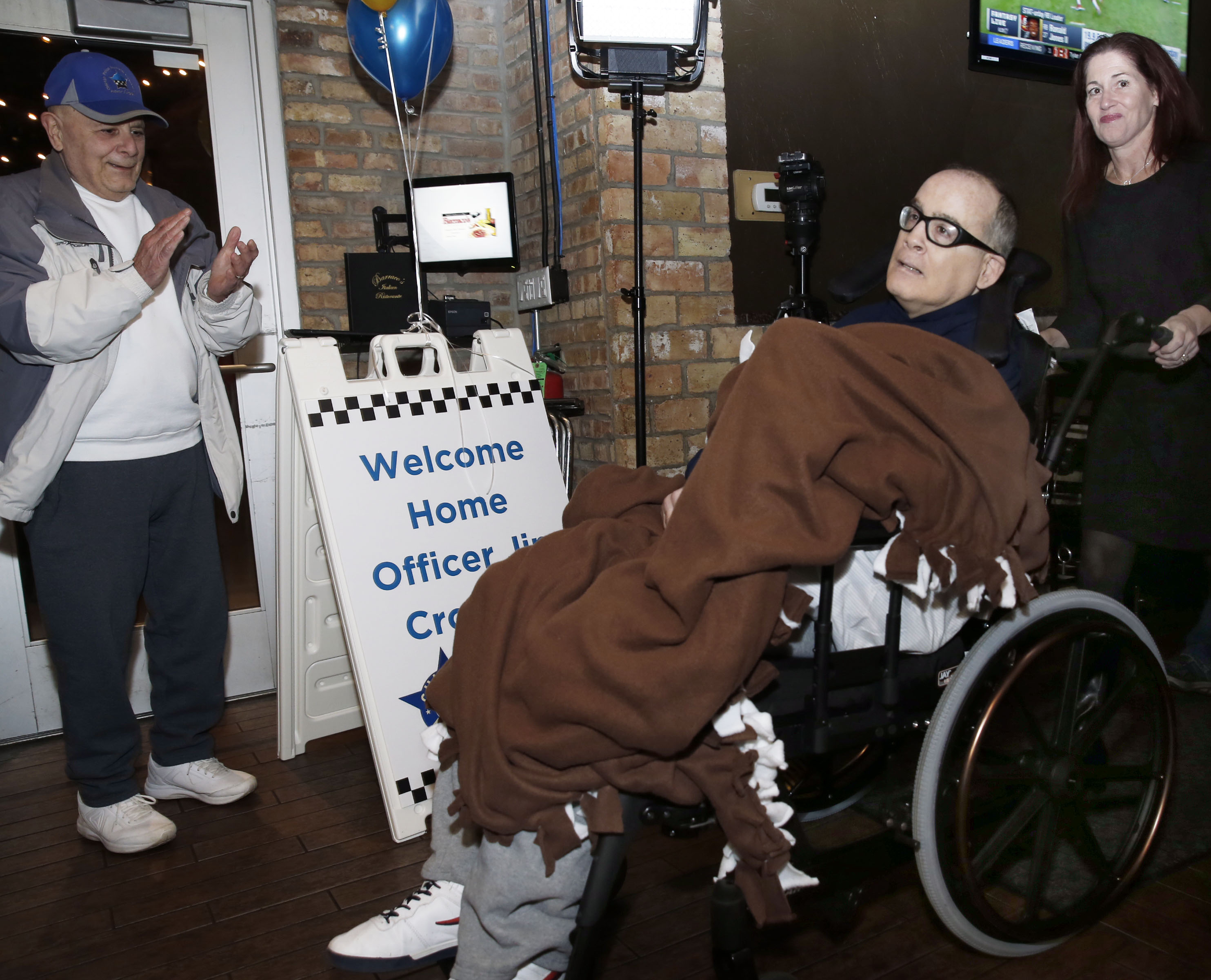 Pushed by his sister, Beth Carter, former CPD officer Jim Crowley is welcomed home for Christmas in Chicago, Monday, December 23, 2019.