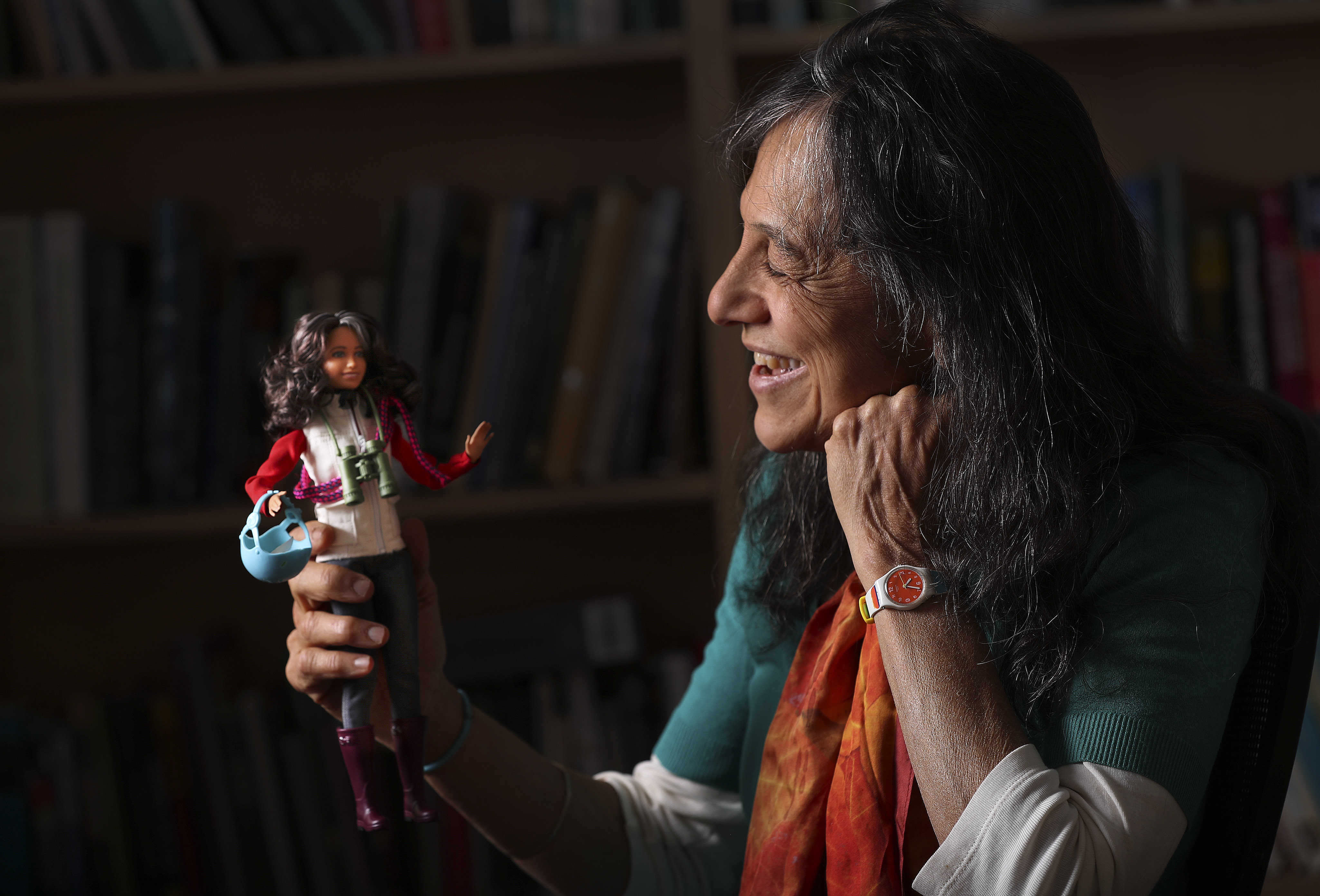 """University of Utah forest ecologist Nalini Nadkarni holds a one-of-a-kind Barbie doll in Salt Lake City on Tuesday, Dec. 3, 2019, that was made in her likeness by Mattel. Nadkarni made her own dolls for years, fashioning what she called """"Treetop Barbies"""" from thrift store finds and handmade accessories."""