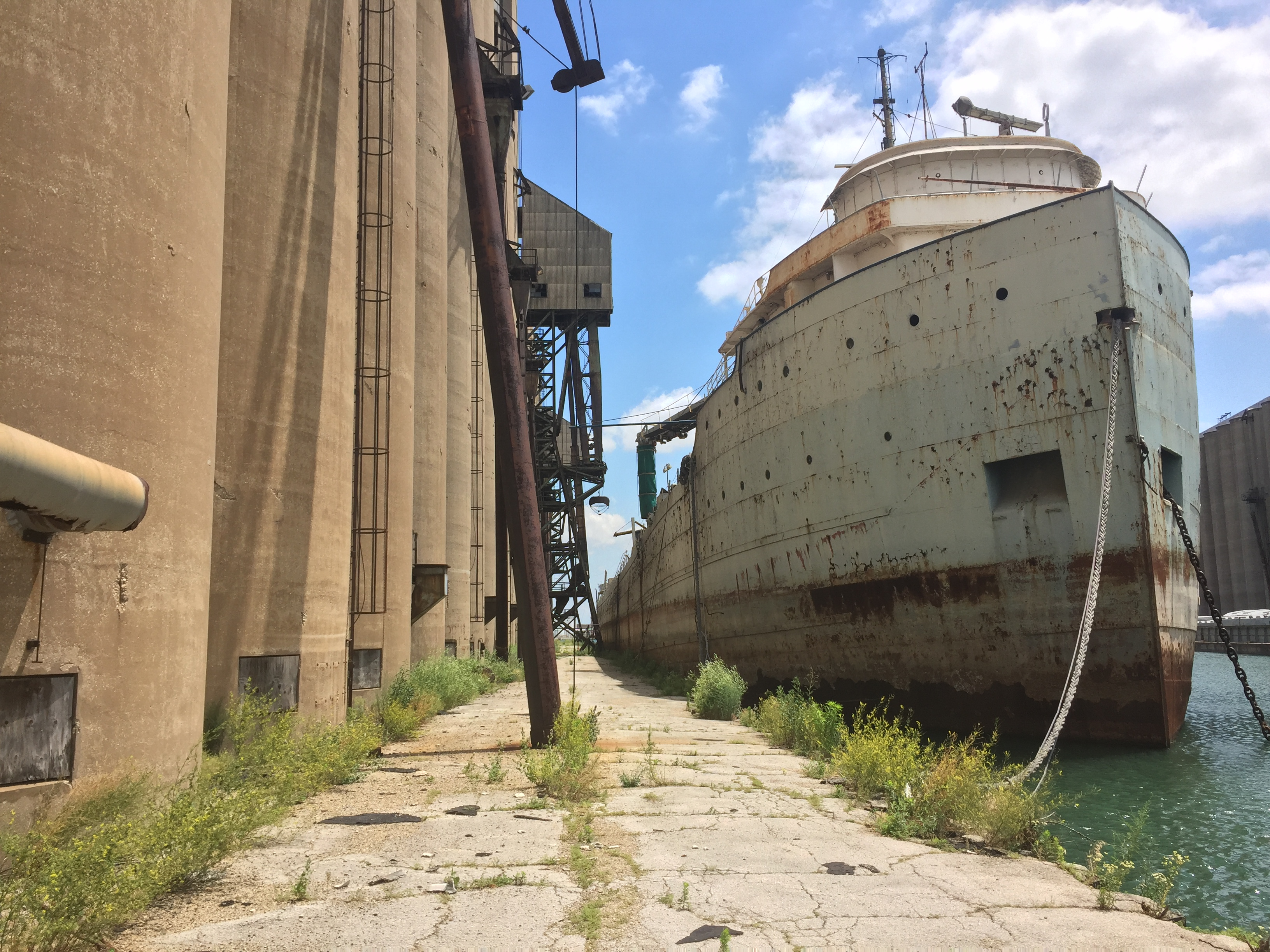 Chicago's Ghost Ship, the C.T.C. 1 — a 620-foot freighter — is scheduled to be hauled away from the Port of Chicago, where it has sat alongside grain silos since 1982.