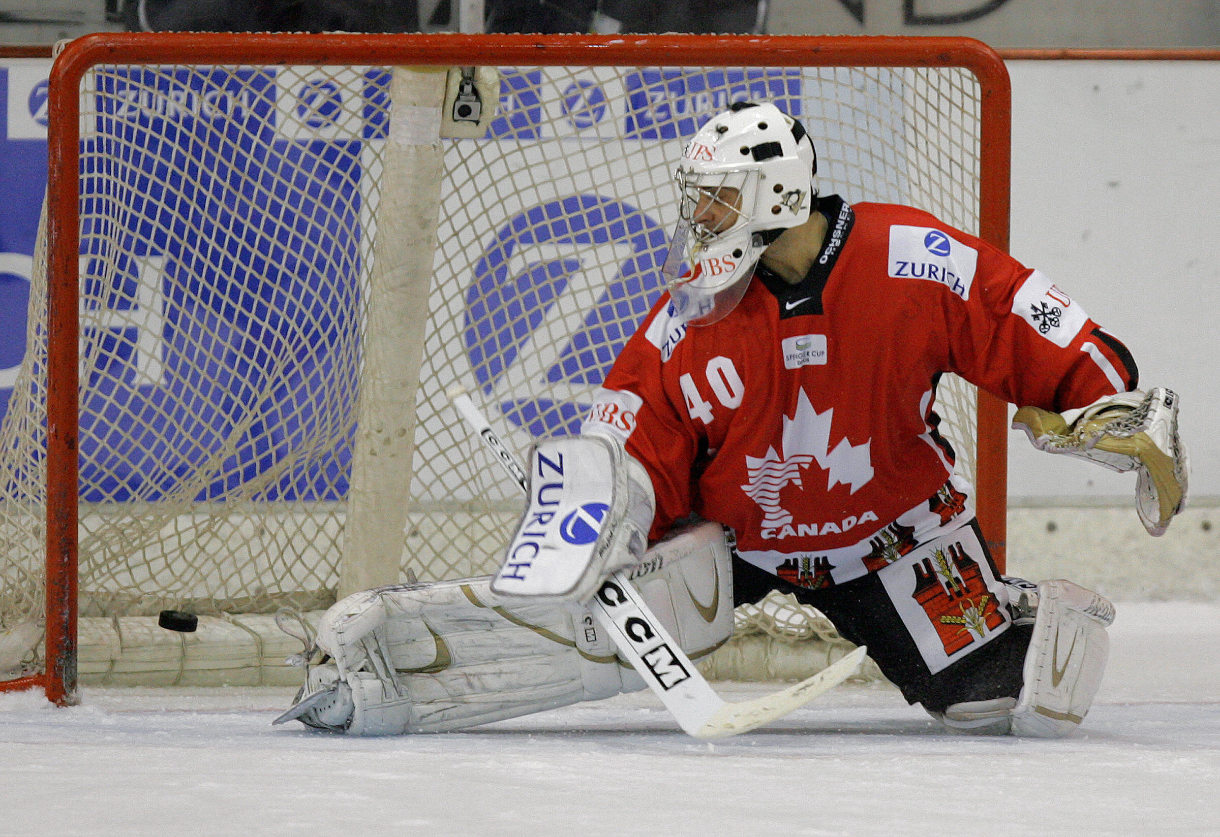 The puck shoots by Team Canada goalkeepe