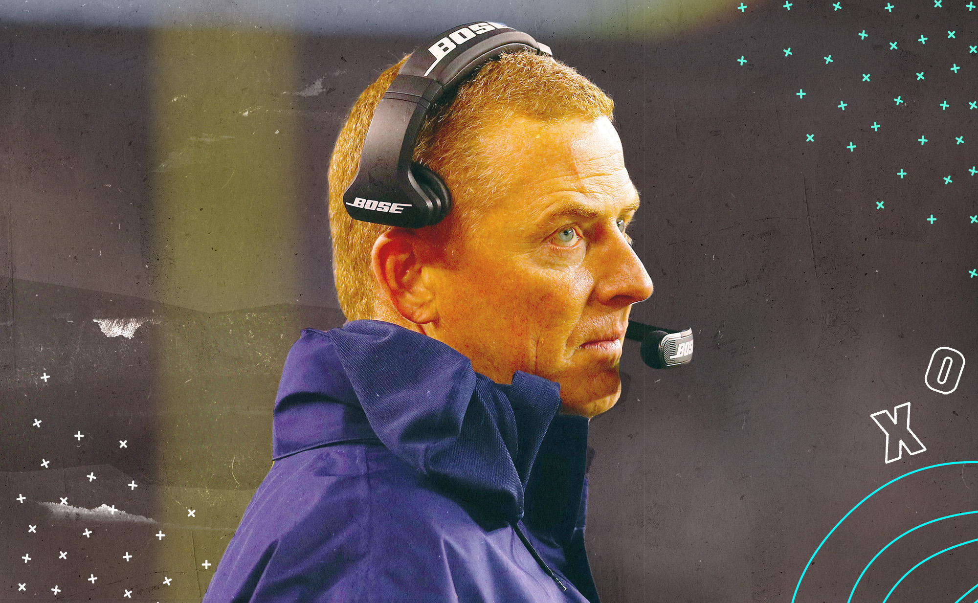 A side profile of Cowboys coach Jason Garrett, wearing a headset with no expression on his face