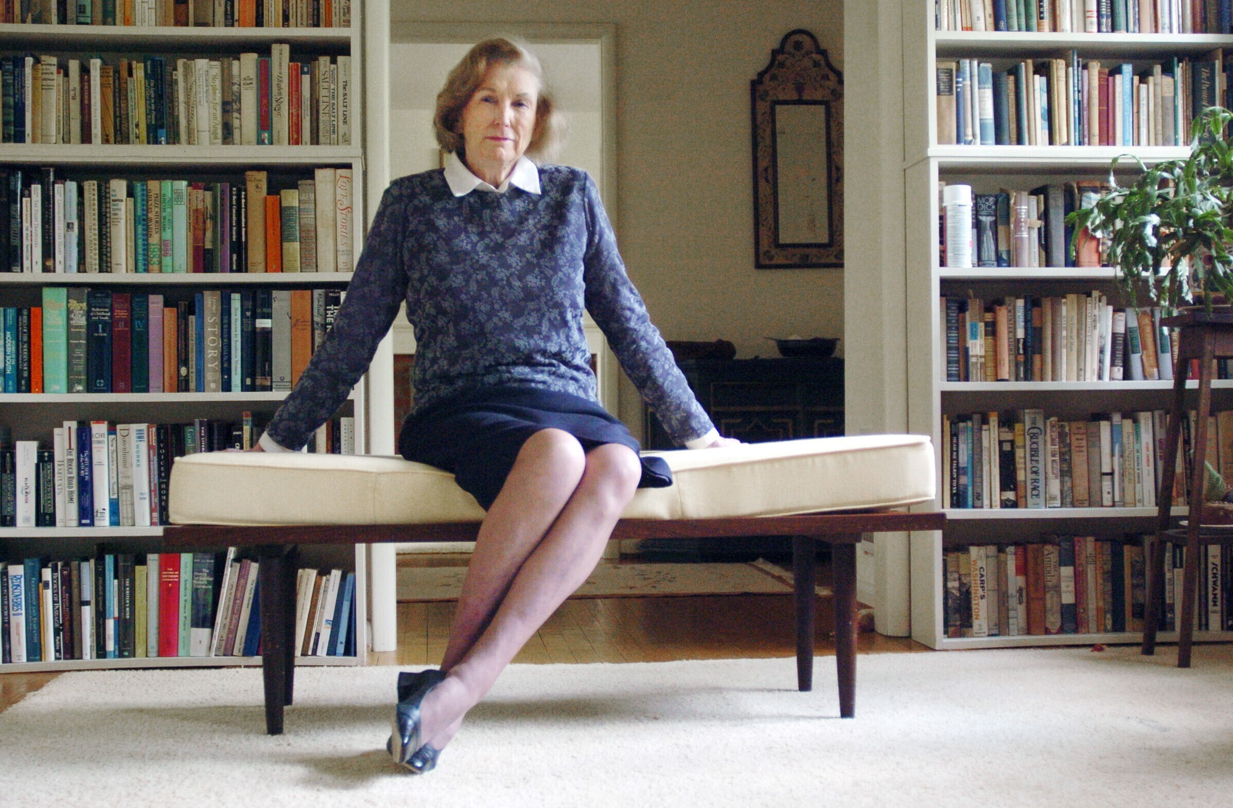 Author Elizabeth Spencer is pictured in Chapel Hill, North Carolina, in front of a personal library in 2005.