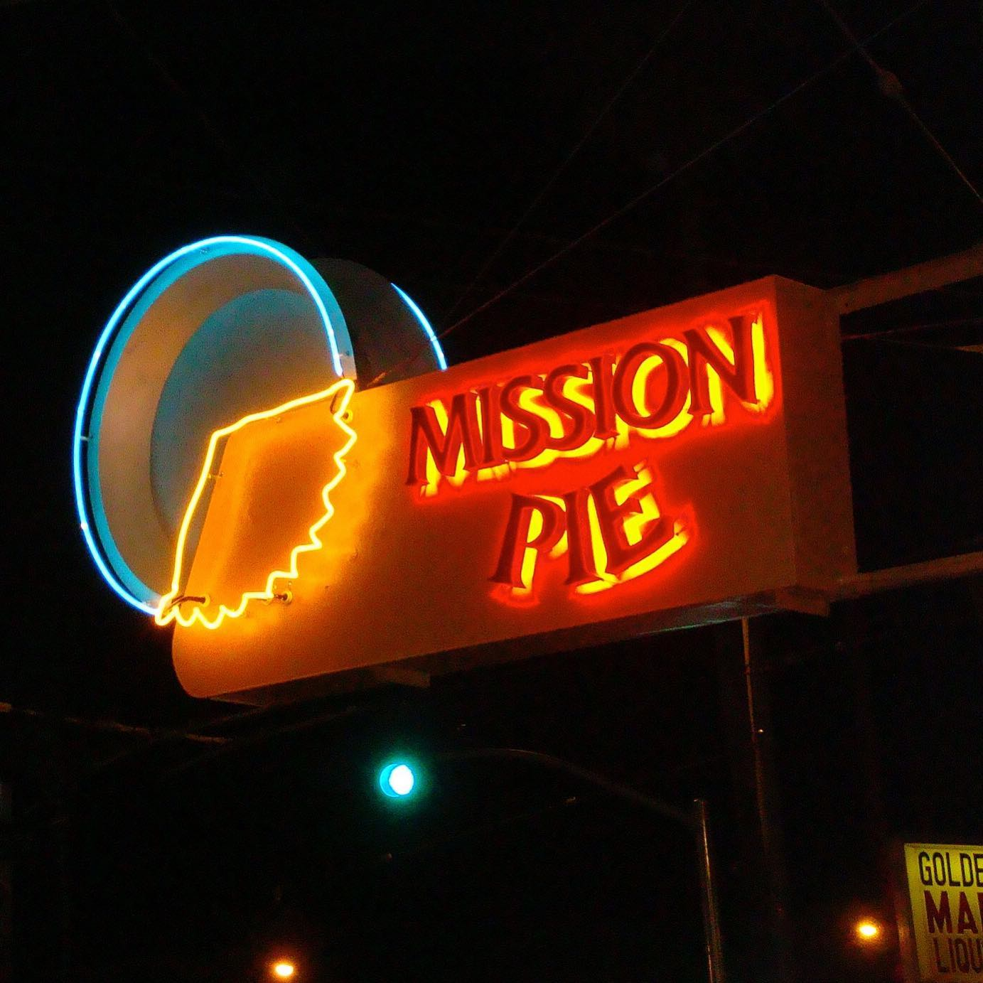The Mission Pie sign at night