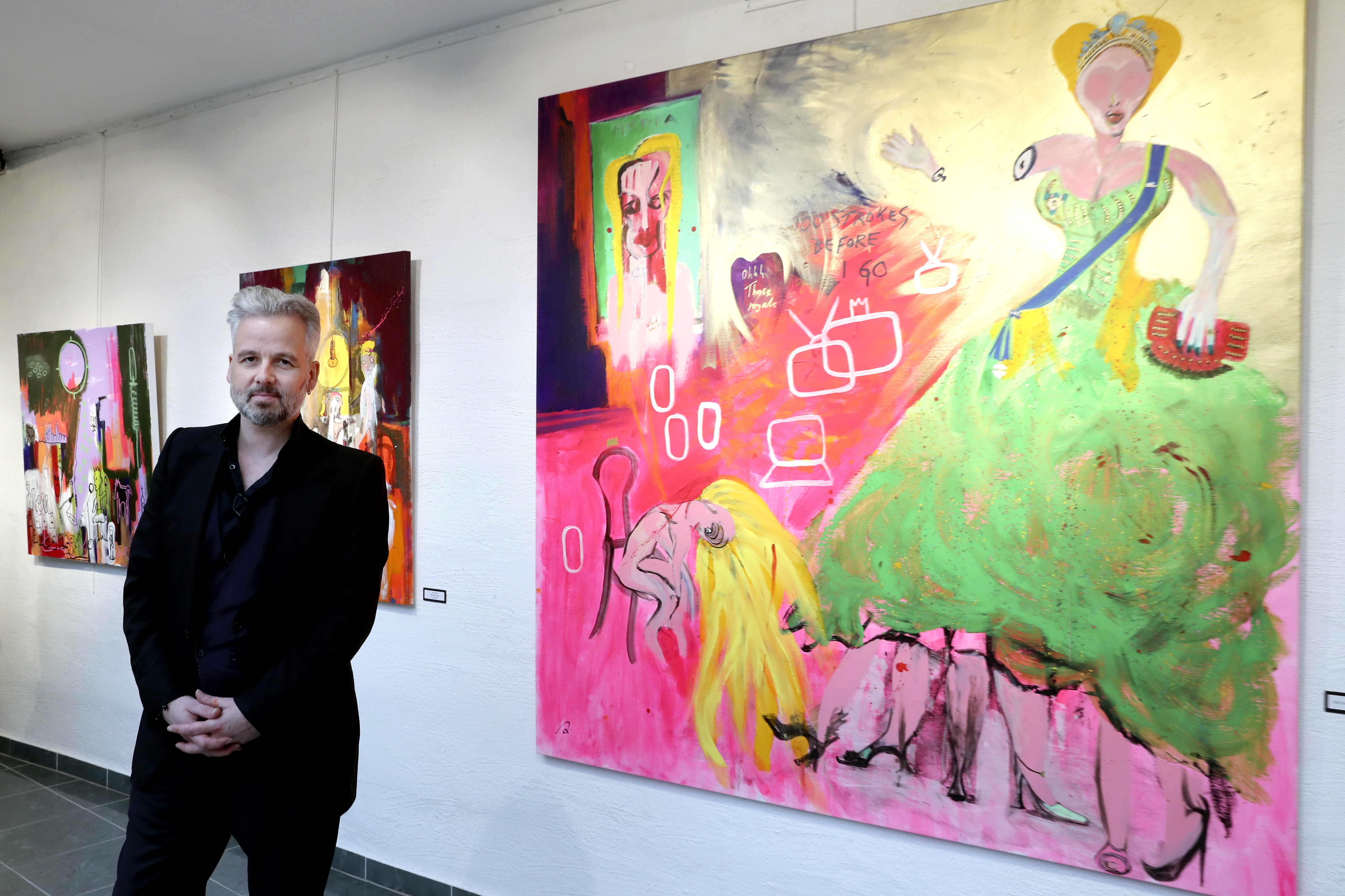 """Ari Behn poses for the media next to the work """"100 strokes before I go"""" during an exhibition in Gallery Oddvar Olsen in Drammen, Norway, in 2017."""