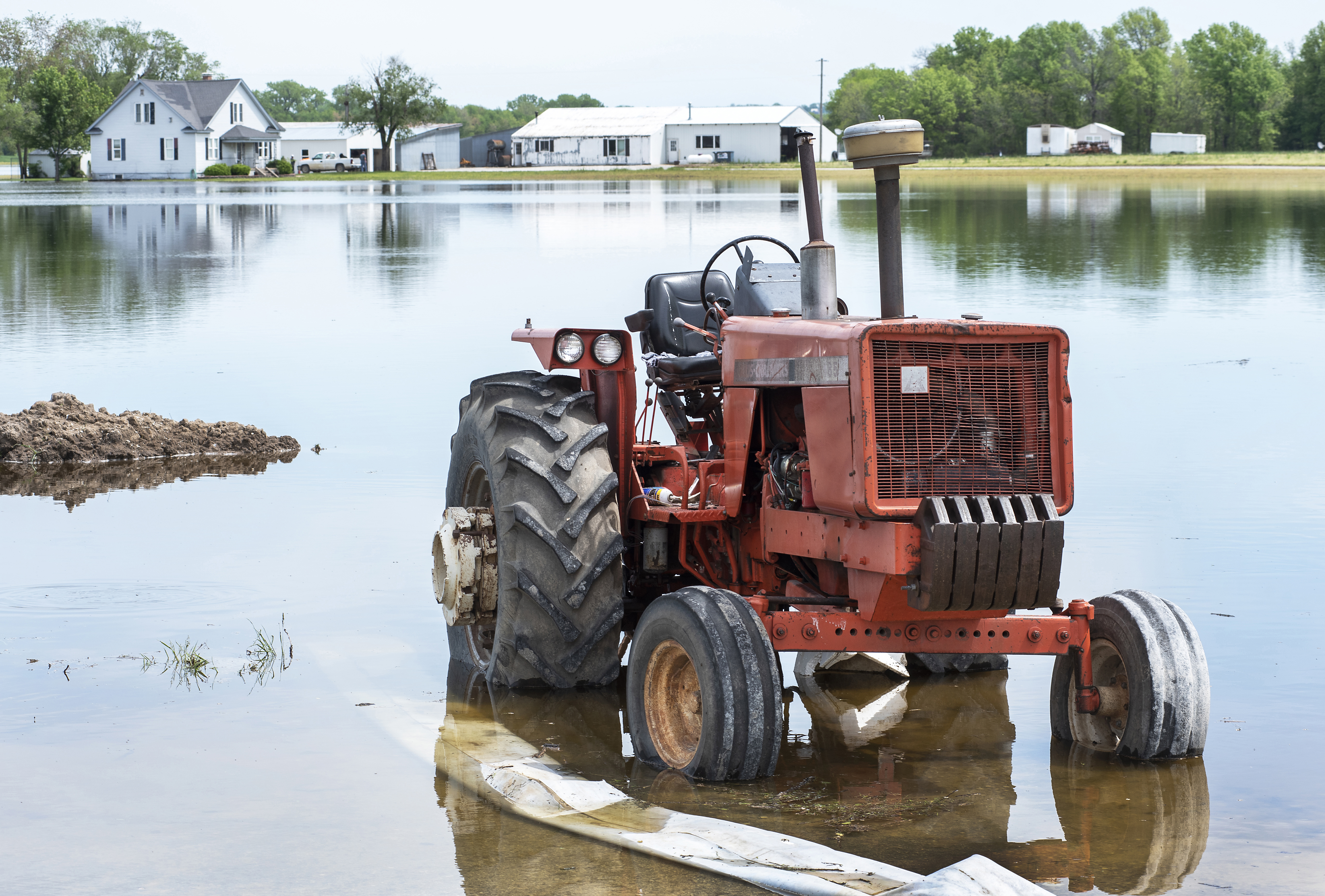 Tractor stranded in Mississippi River flood waters off Highway 79 in Winfield, MO, north of St. Louis on May 5, 2019.