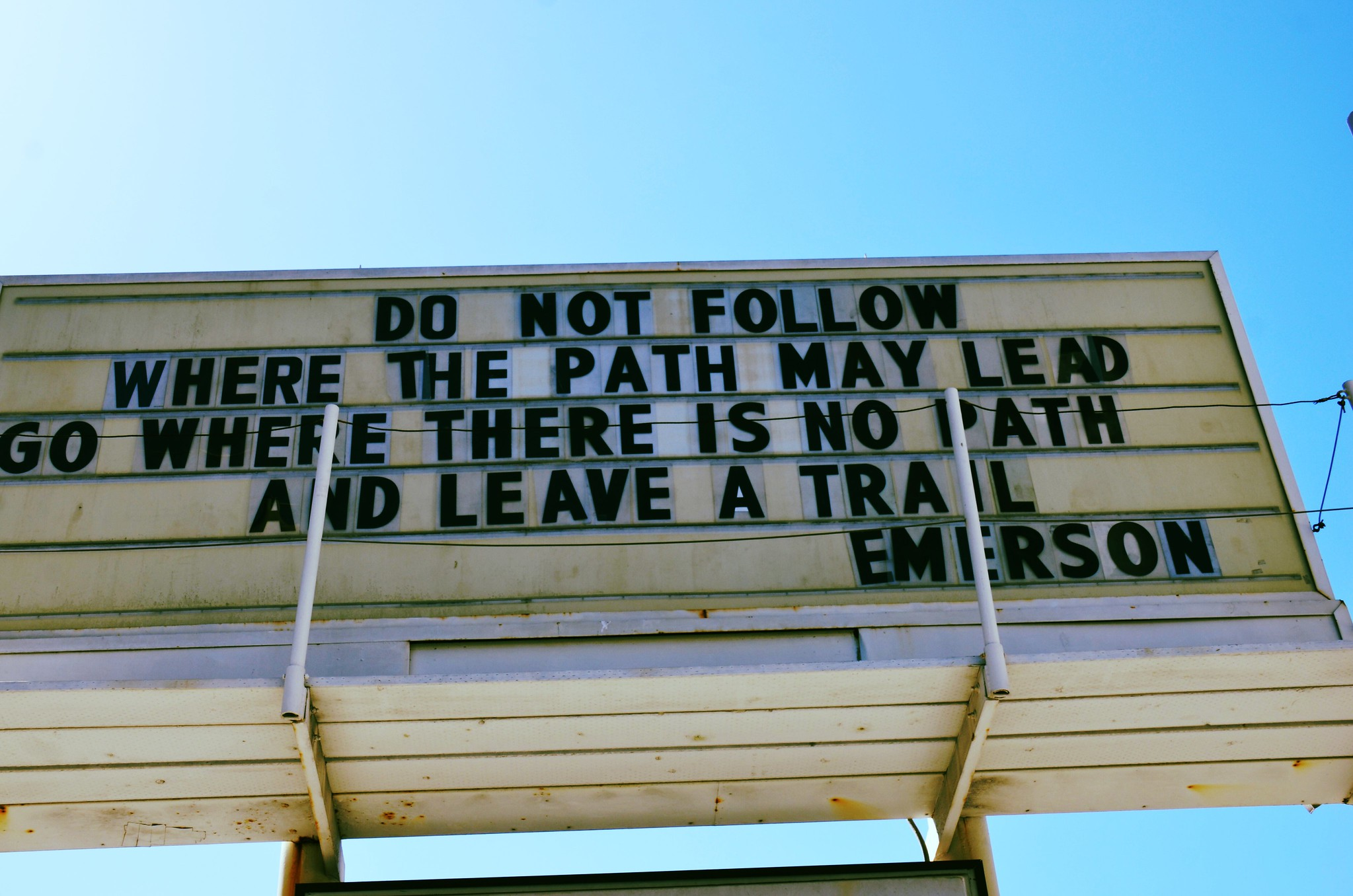 """A sign reading, """"Do not go where the path may lead, go instead where there is no path and leave a trail."""""""
