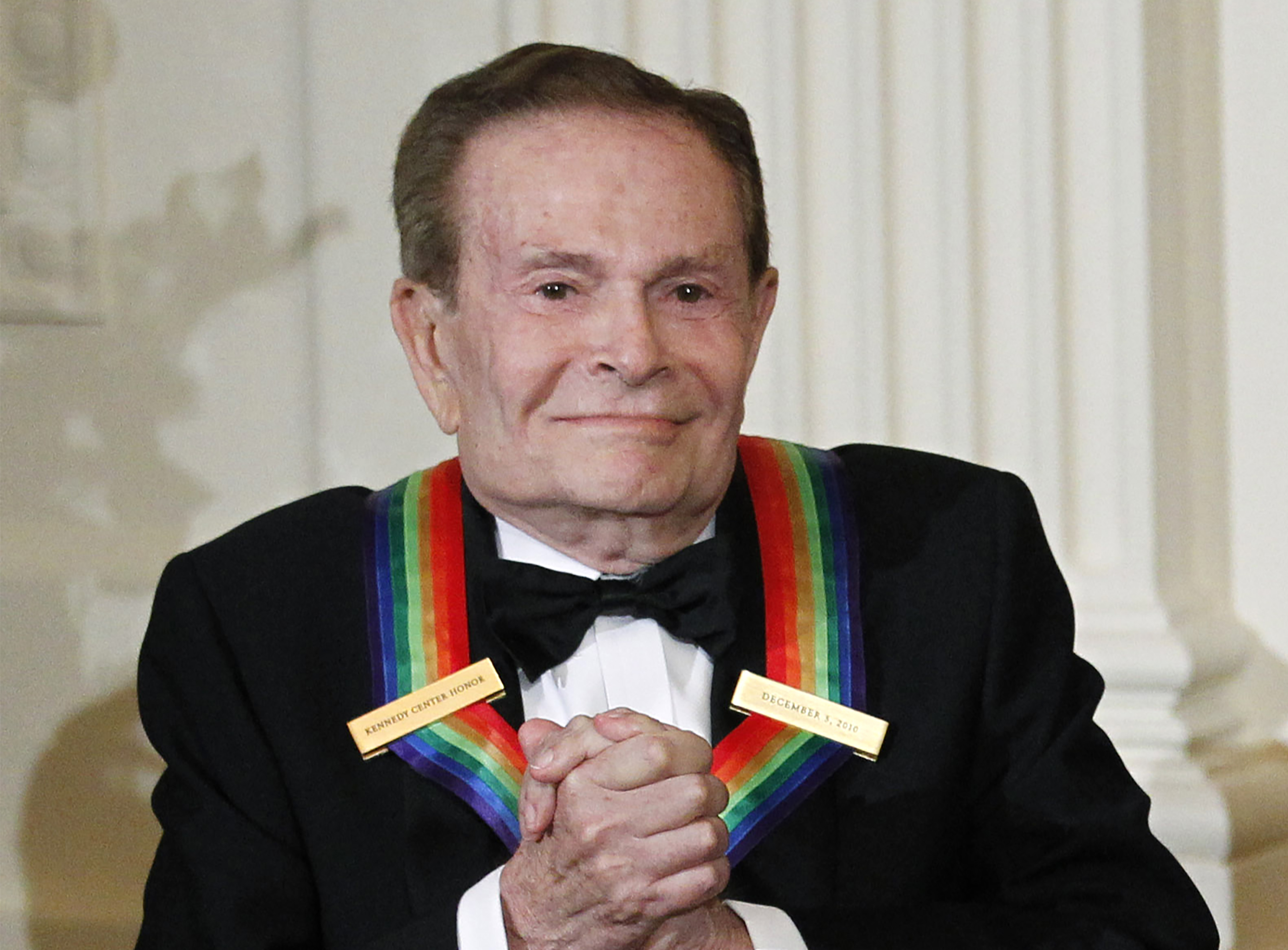 In this Dec. 5, 2010, file photo, composer Jerry Herman, one of the recipients of the 2010 Kennedy Center Honors is introduced during a reception in the East Room of the White House in Washington.