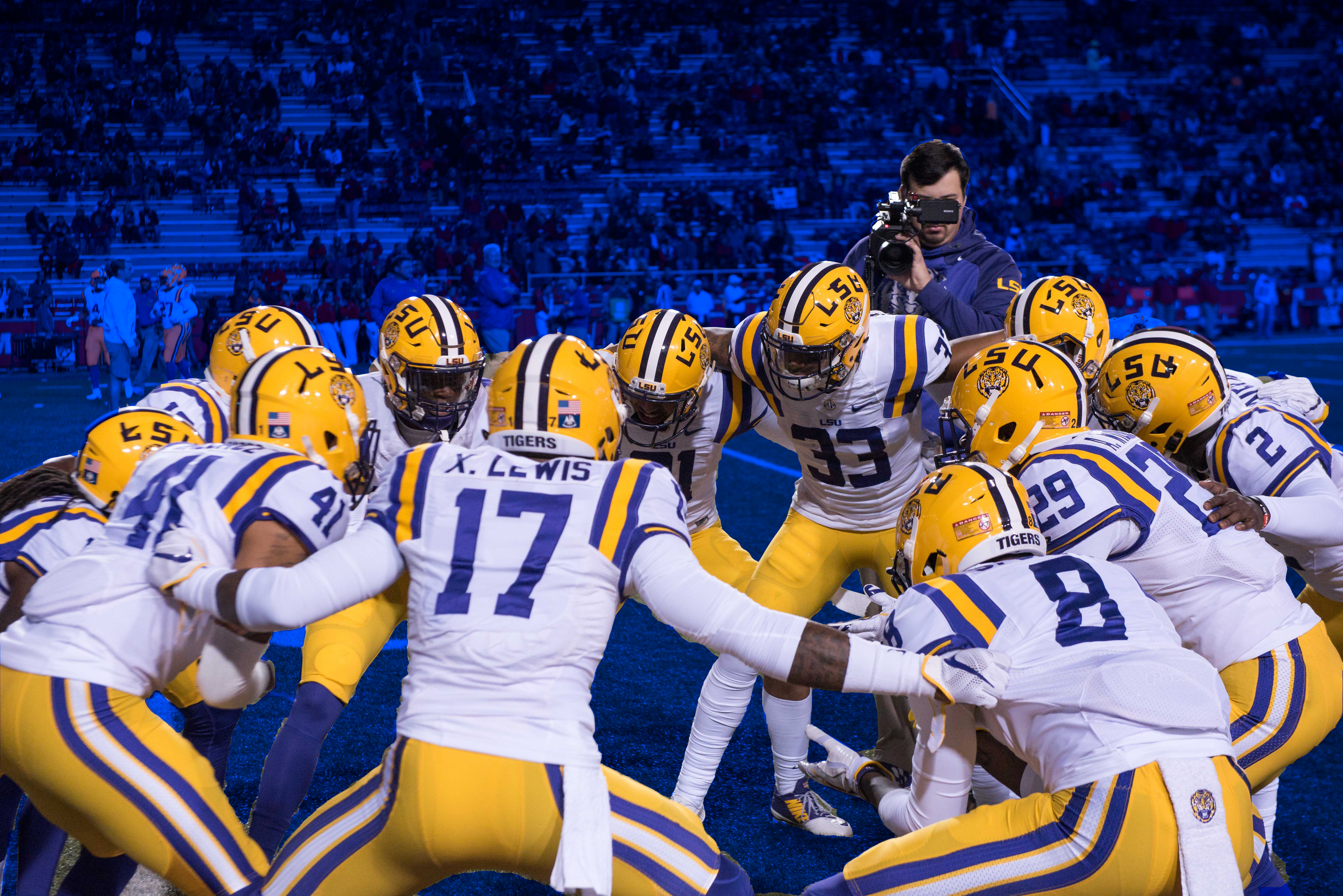 LSU players huddle before a game.