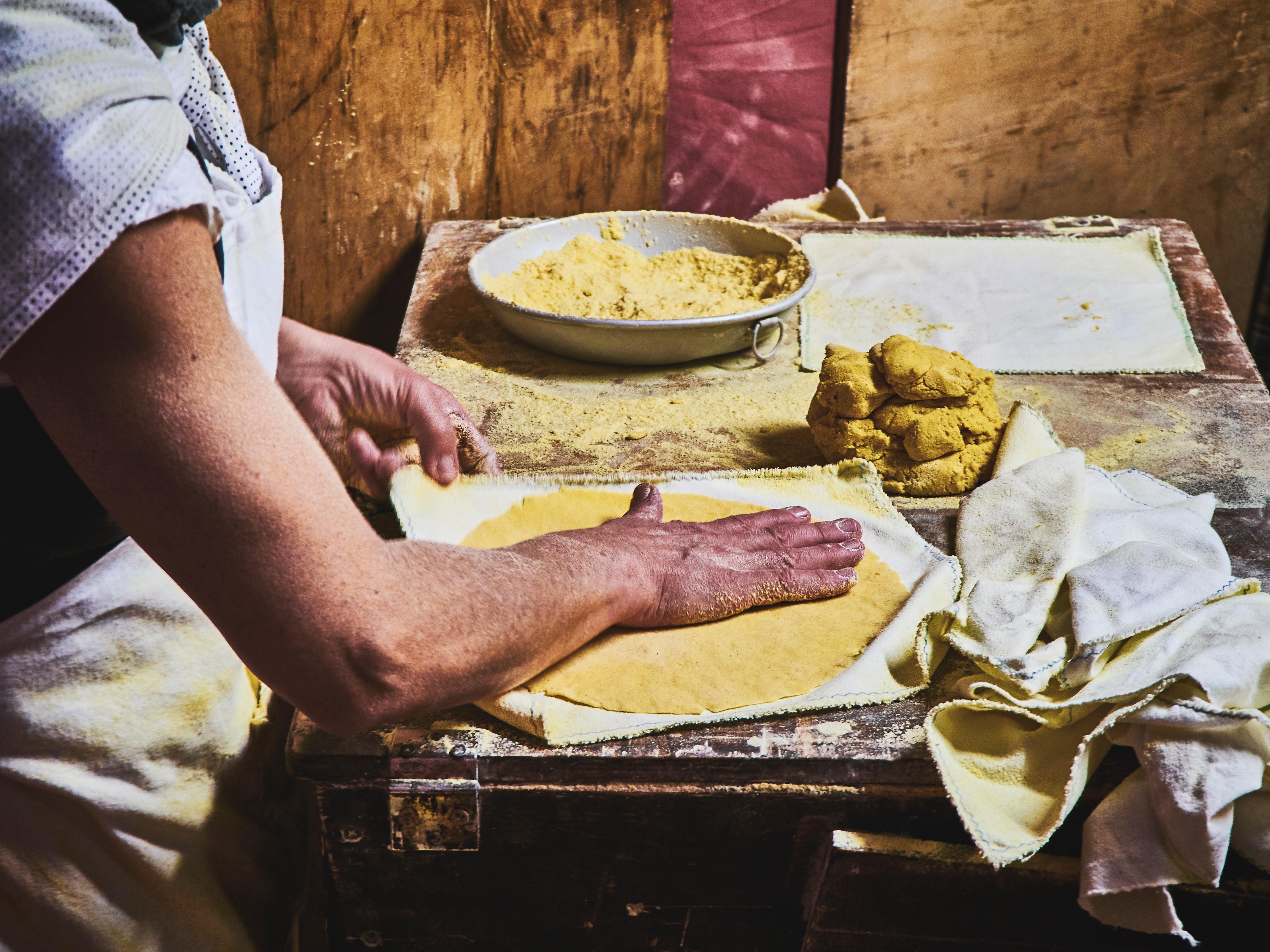 A person making a tortilla