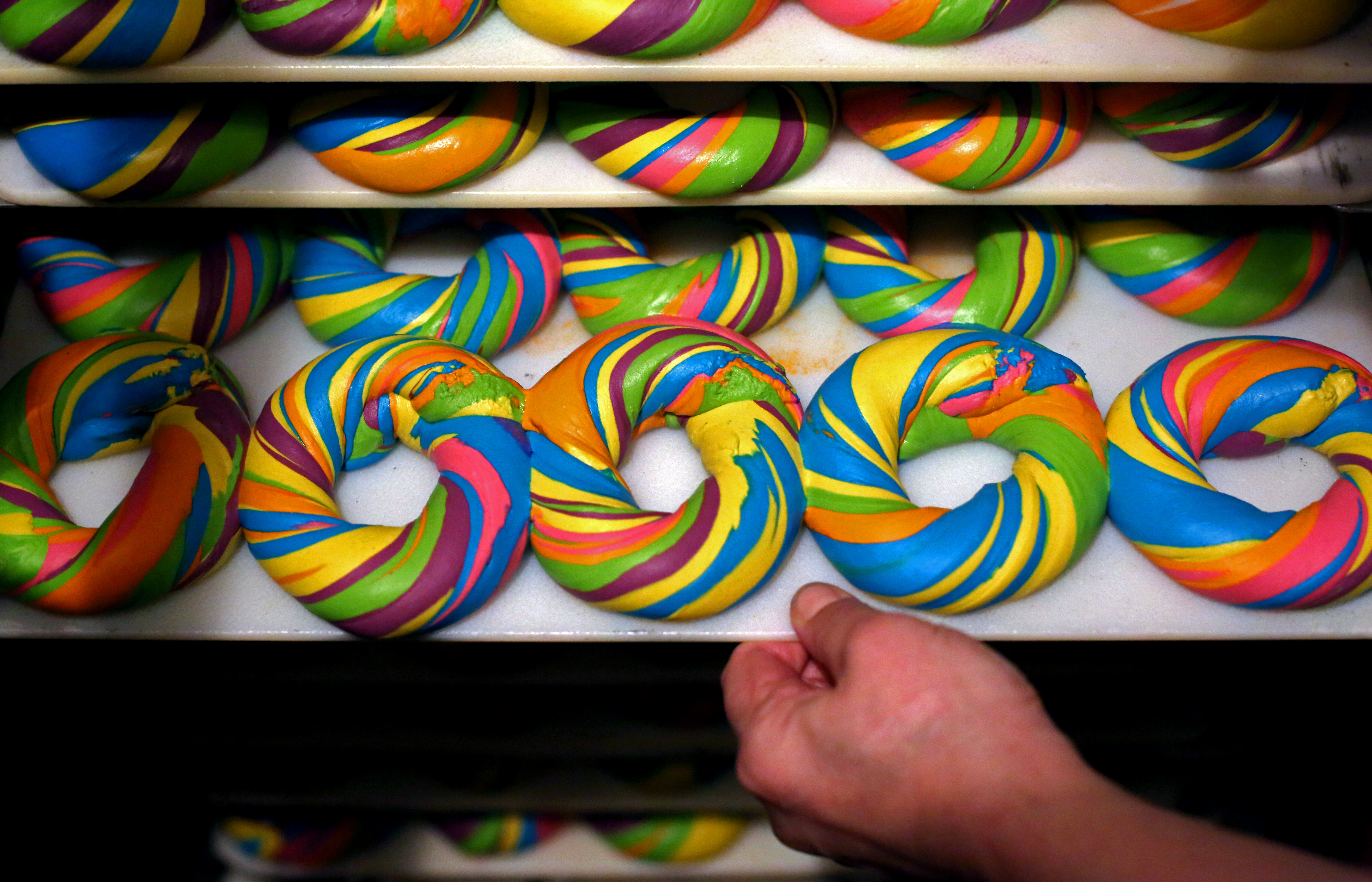 BROOKLYN, NY - APRIL 09: A tray of baked Rainbow Bagels is seen