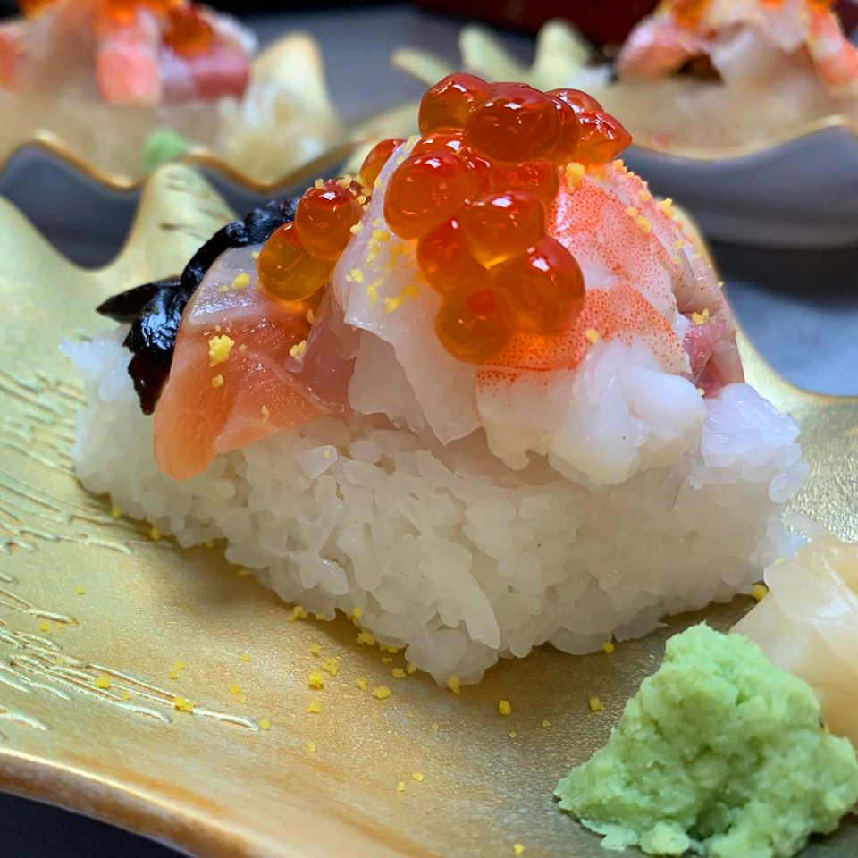 Chirashi sushi served during a multi-dish meal at Kaiseki Yuzu.