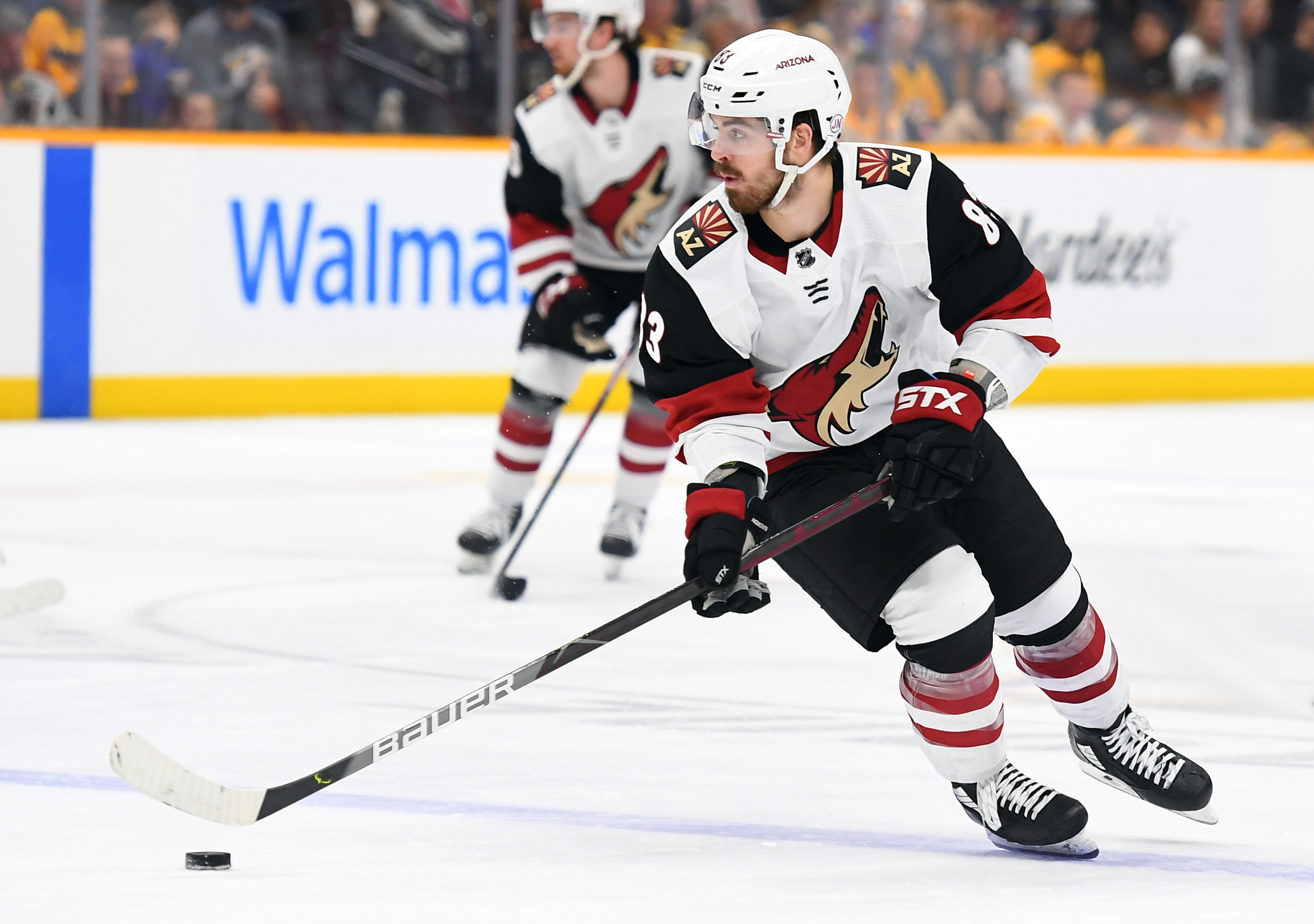Dec 23, 2019; Nashville, Tennessee, USA; Arizona Coyotes right wing Conor Garland (83) skates the puck into the offensive zone during the second period against the Nashville Predators at Bridgestone Arena.