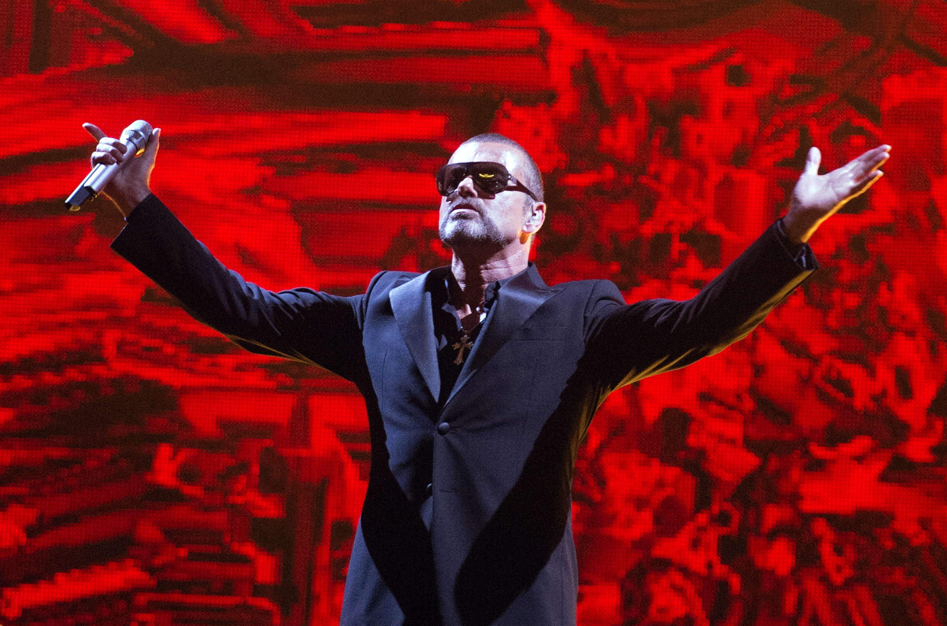 George Michael performs on stage during a charity gala in Paris in 2012. His sister died on Christmas Day, three years to the date of his passing.