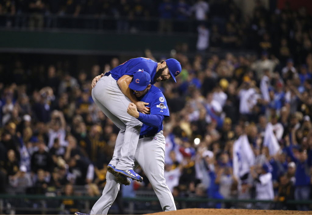 Anthony Rizzo and Jake Arrieta celebrate after winning a playoff game in 2015.