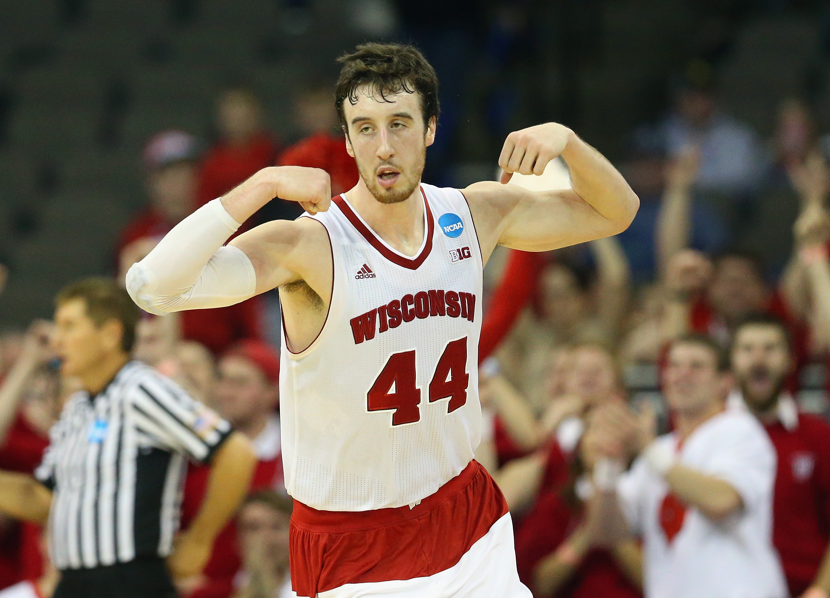Wisconsin's Frank Kaminsky flexed his muscles after making a late basket to extend the lead over Oregon.