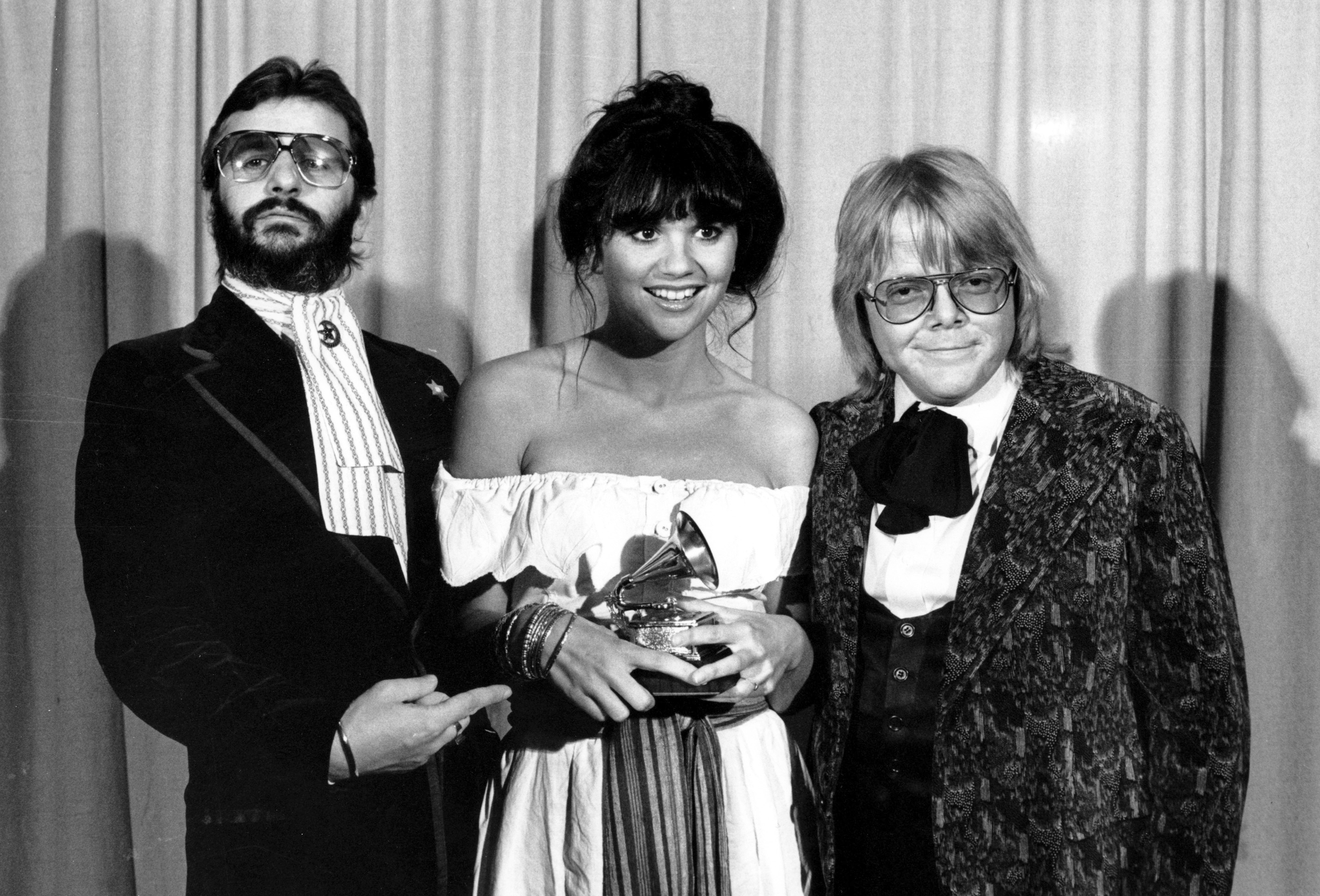 """SingerLinda Ronstadt is flanked by Ringo Starr  and Paul Williams after she was named best pop singer for her """"Hasten Down the Wind"""" at the 19th Annual Grammy Awards in Los Angeles in 1977."""