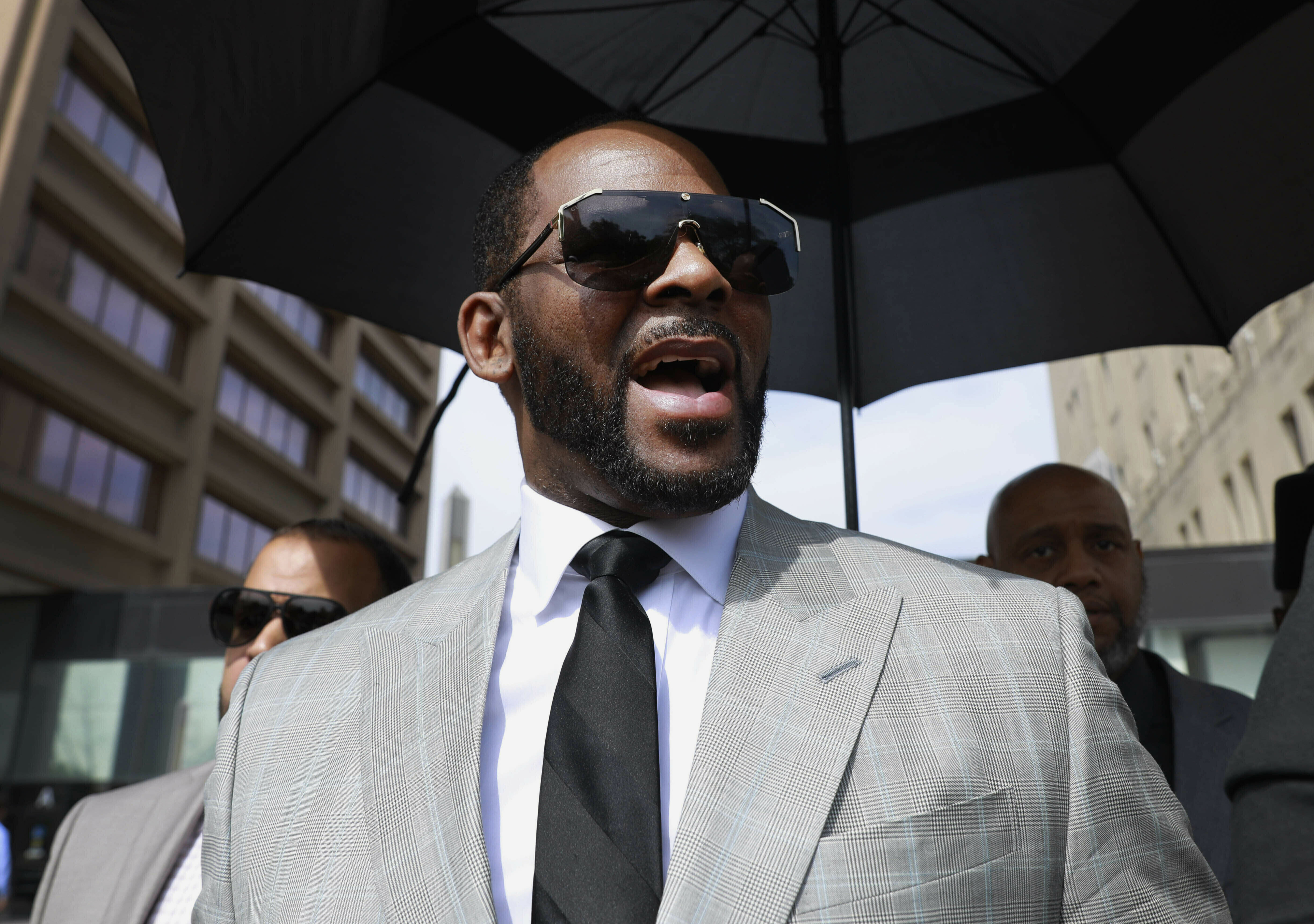 Musician R. Kelly leaves the Leighton Criminal Court building in Chicago in June.