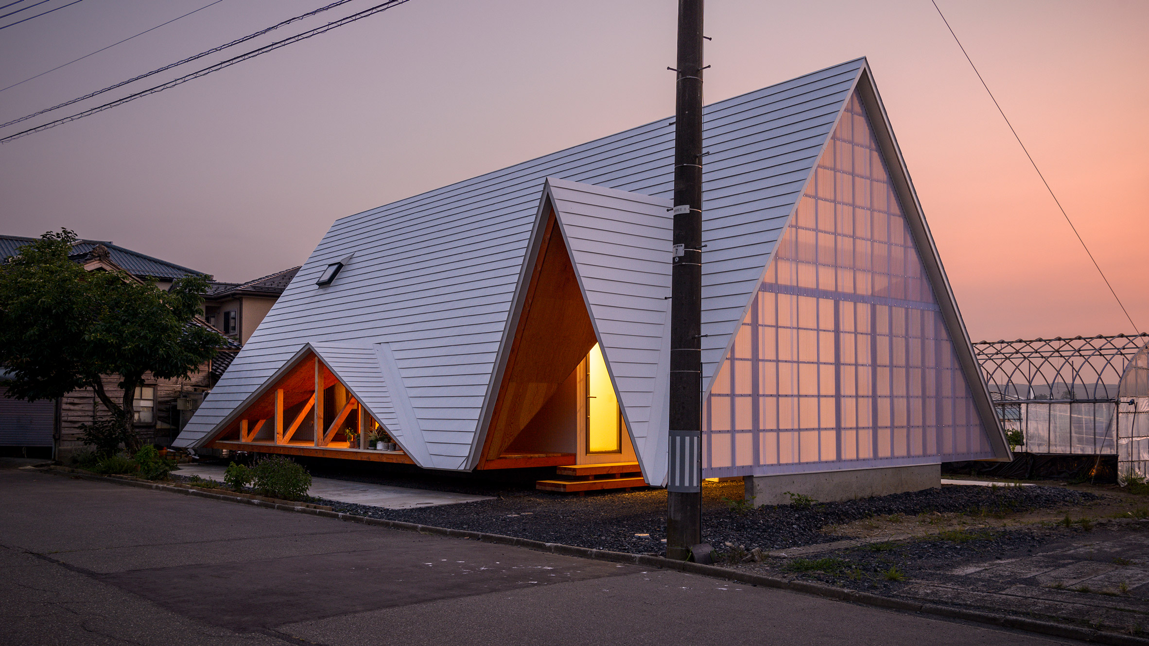 House shaped like a tent glowing at dusk.