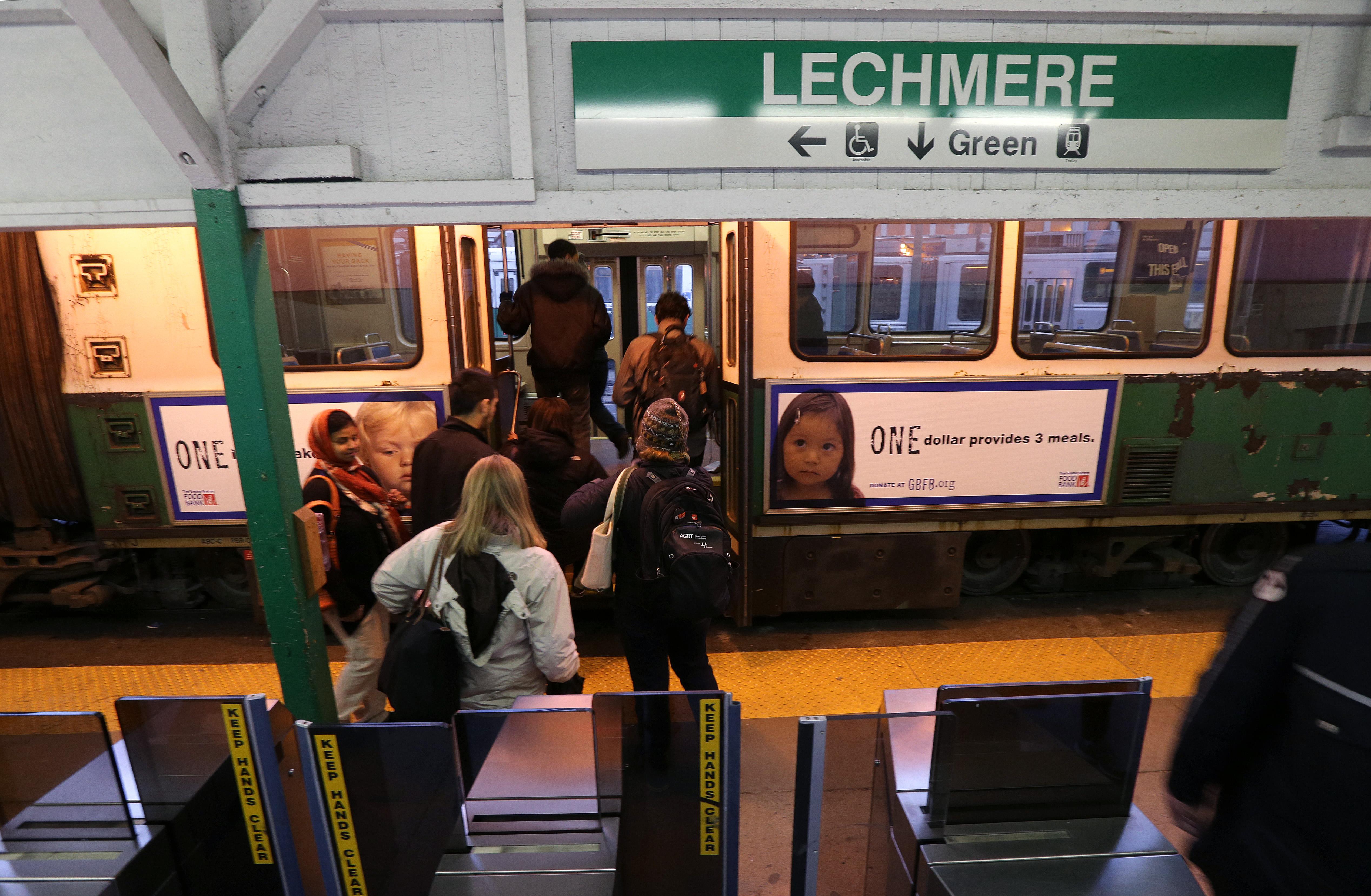 People boarding a subway trolley.