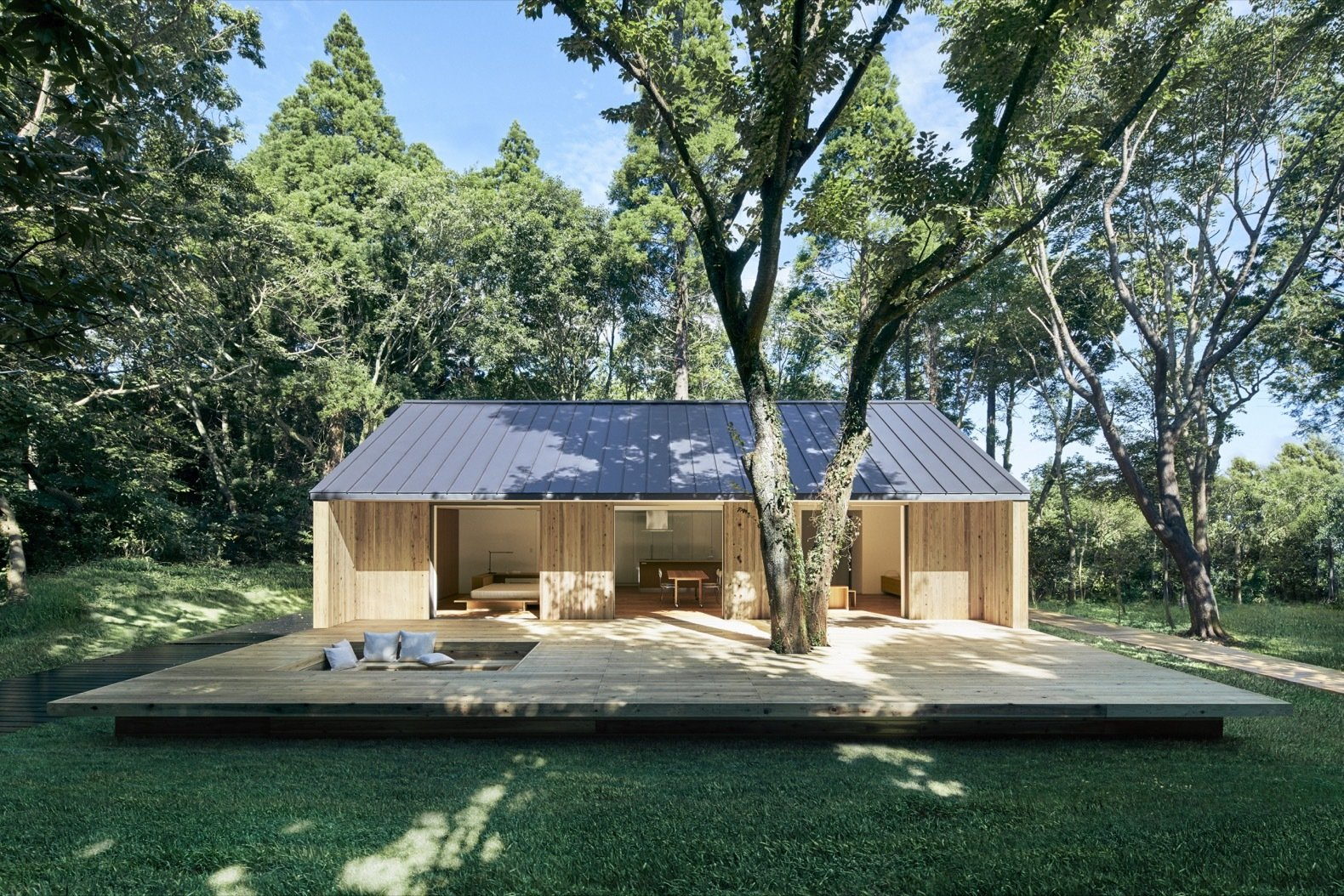 Single-story timber prefab home on grassy lawn.