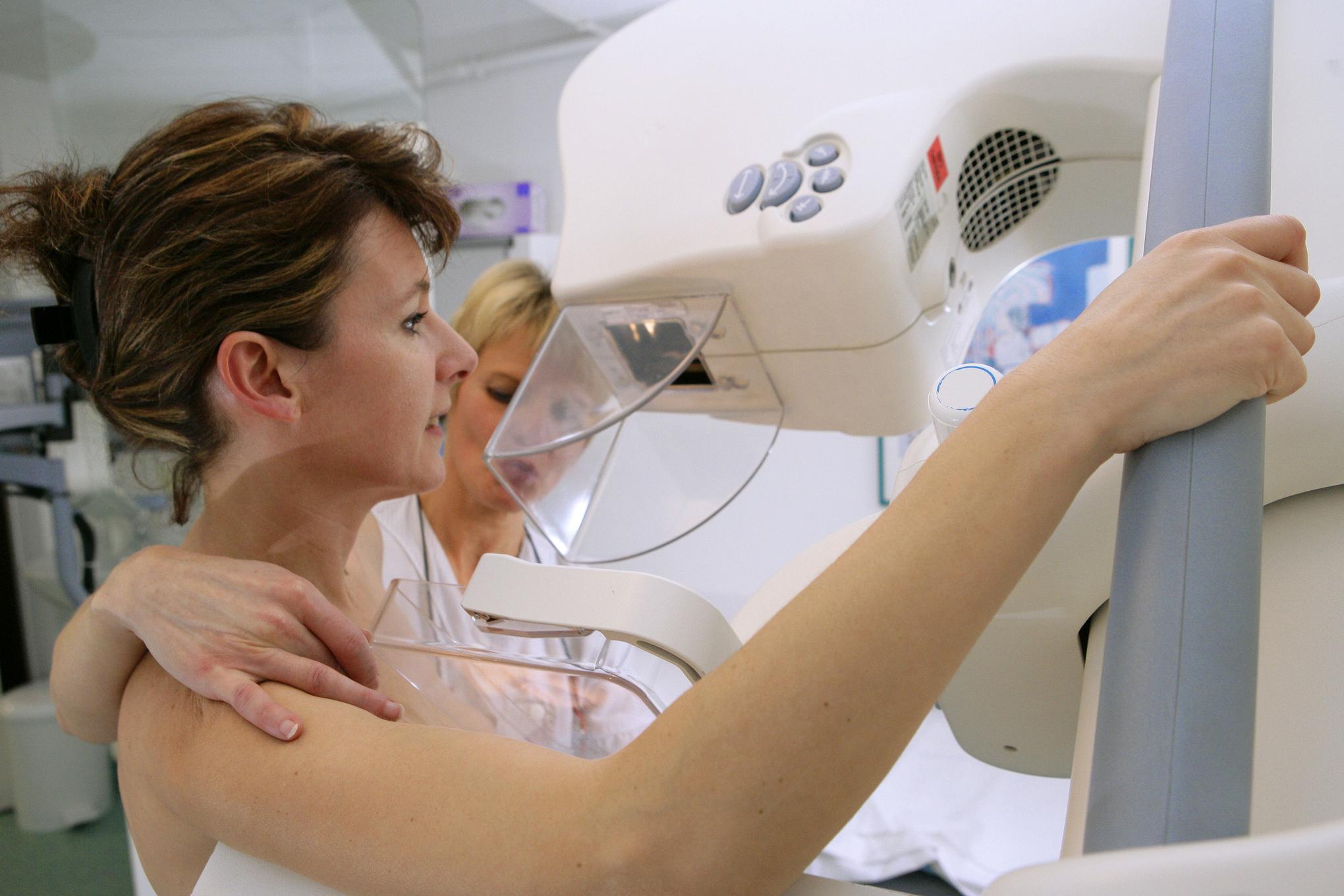 A woman being given a mammogram.
