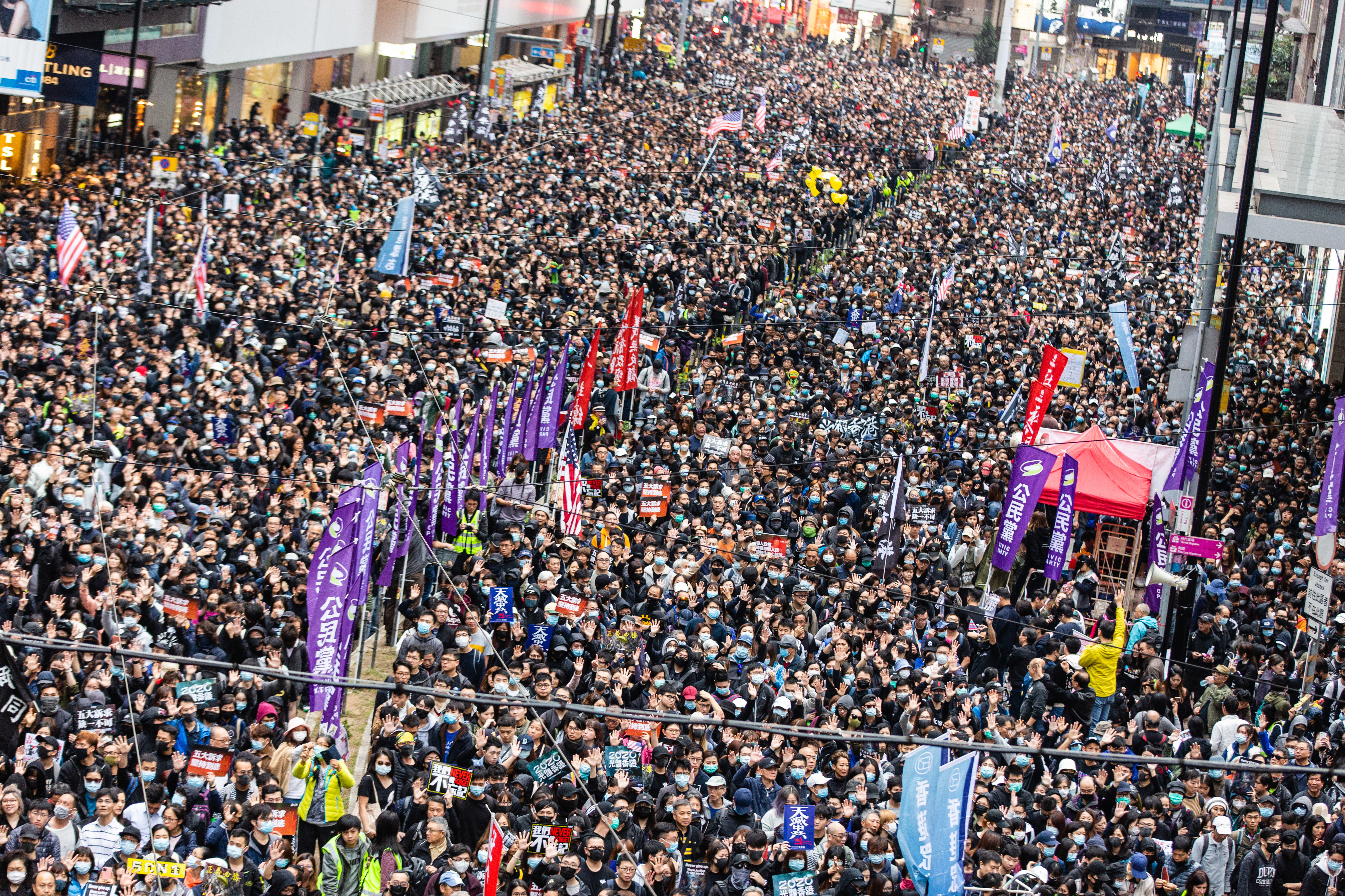 Crowds of protesters marching on the streets of Hong Kong...