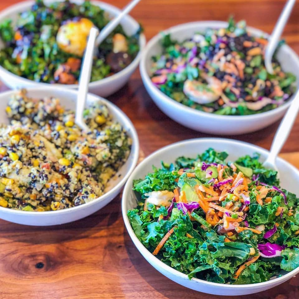 Four bowls of kale, leafy greens, and grain salads at Upbeet on Howell Mill Road, Atlanta