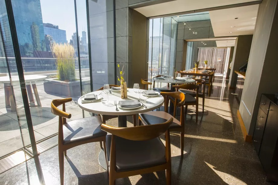 The stylish dining space features floor-to-ceiling windows that offer sweeping views.