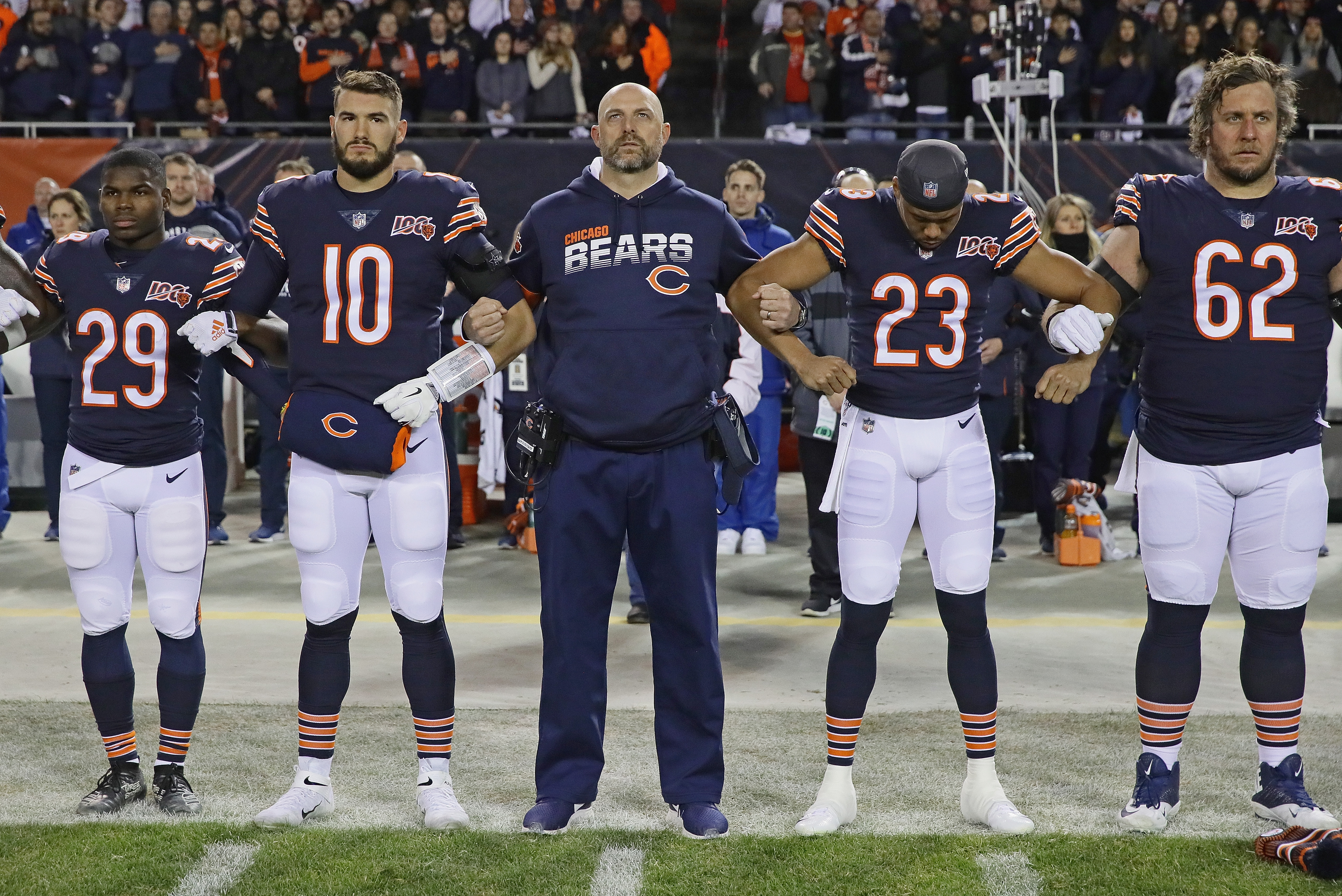 Bears coach Matt Nagy stands with Tarik Cohen, Mitch Trubisky, Kyle Fuller and Ted Larsen during the national anthem before the Chiefs game.