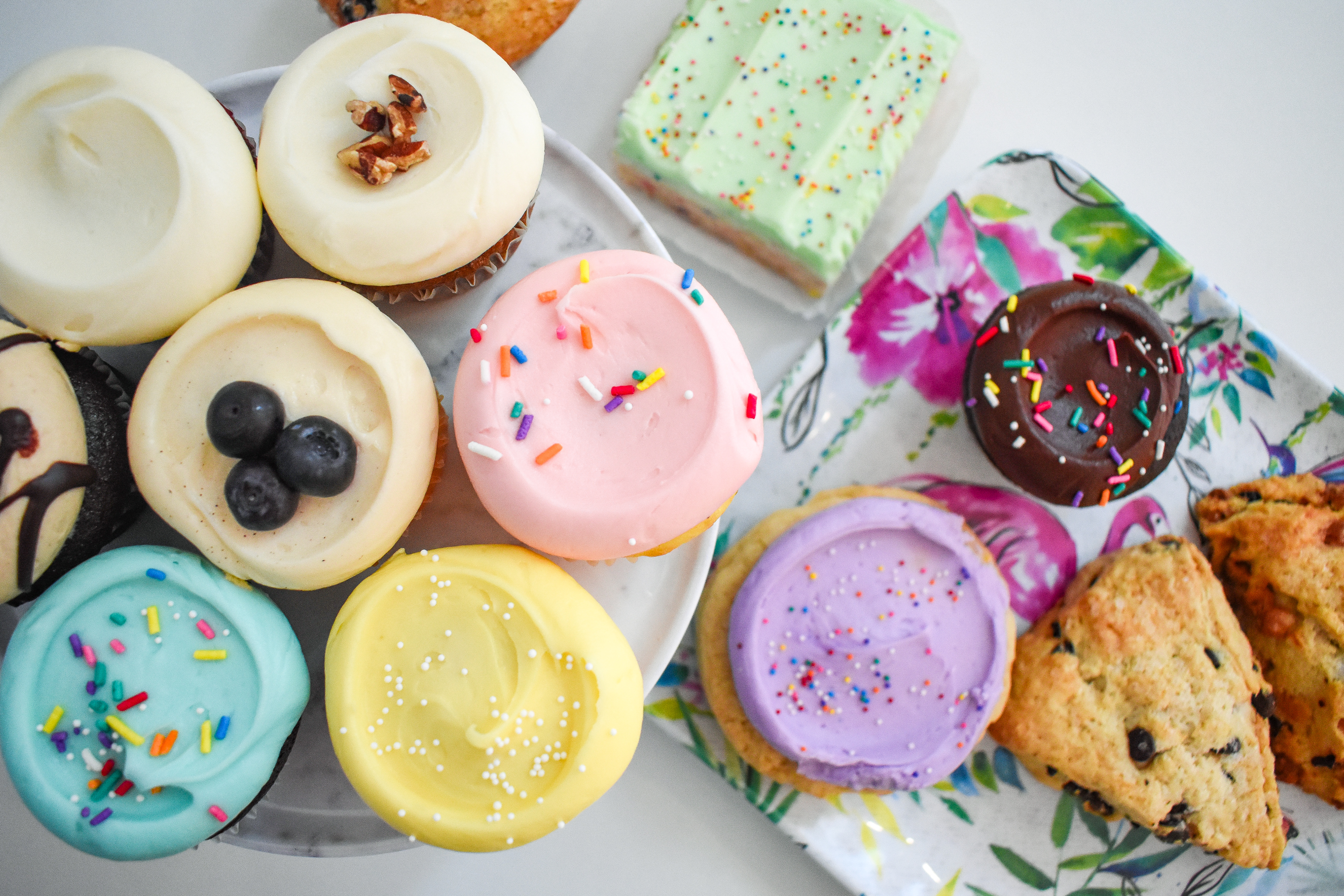 A table filled with cupcakes and baked goods.